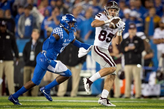 Mississippi State wide receiver Austin Williams (85) catches a pass and is tackled by Kentucky safety Davonte Robinson (9) during the second half of an NCAA college football game in Lexington, Ky., Saturday, Sept. 22, 2018. (AP Photo/Bryan Woolston)