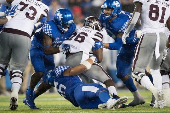 Mississippi State running back Aeris Williams (26) is tackled by several Kentucky defenders during the second half of an NCAA college football game in Lexington, Ky., Saturday, Sept. 22, 2018. (AP Photo/Bryan Woolston)