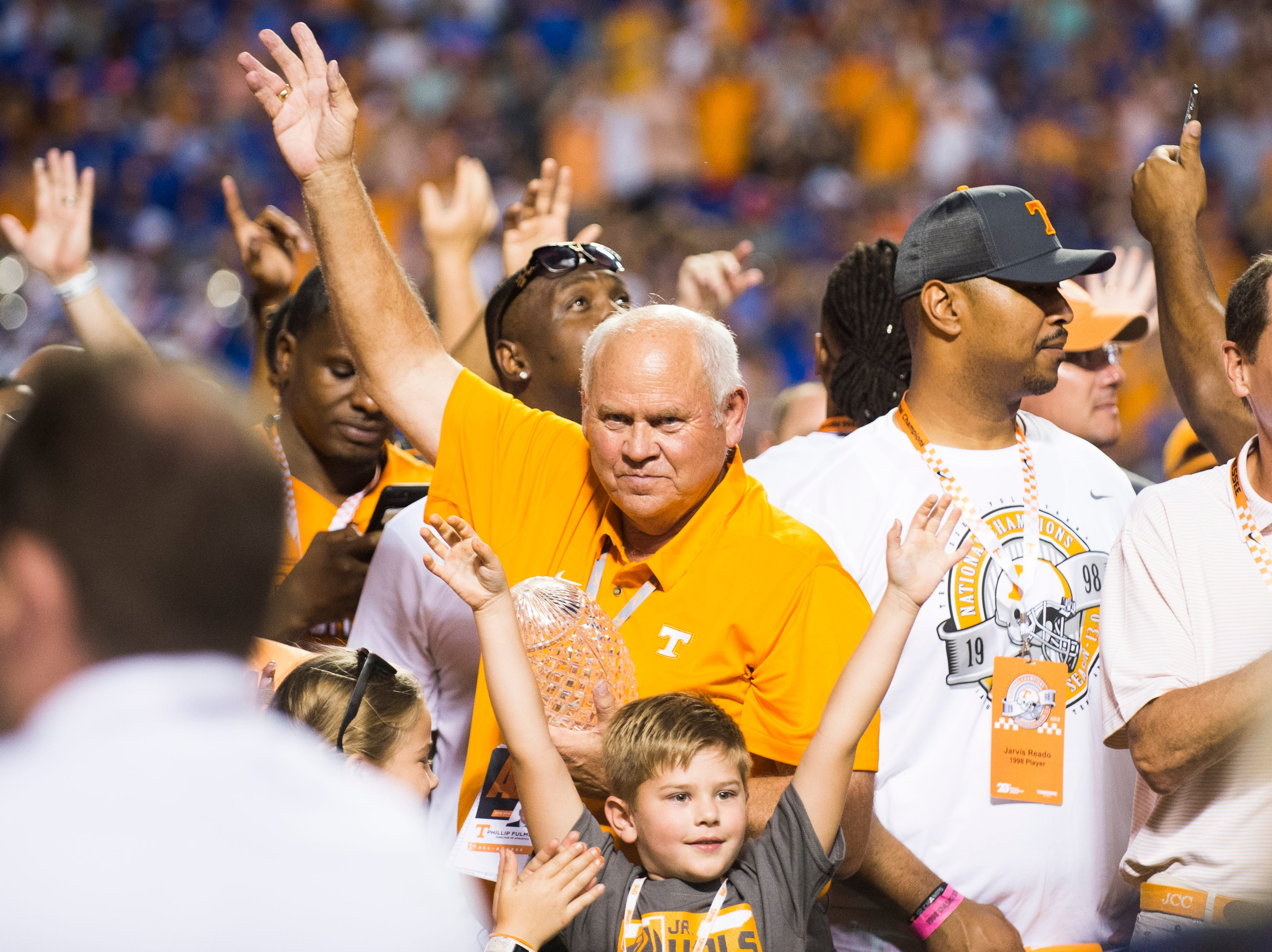 Phillip Fulmer celebrates with the 1998 championship team during a game between Tennessee and Florida at Neyland Stadium in Knoxville, Tennessee on Saturday, September 22, 2018.