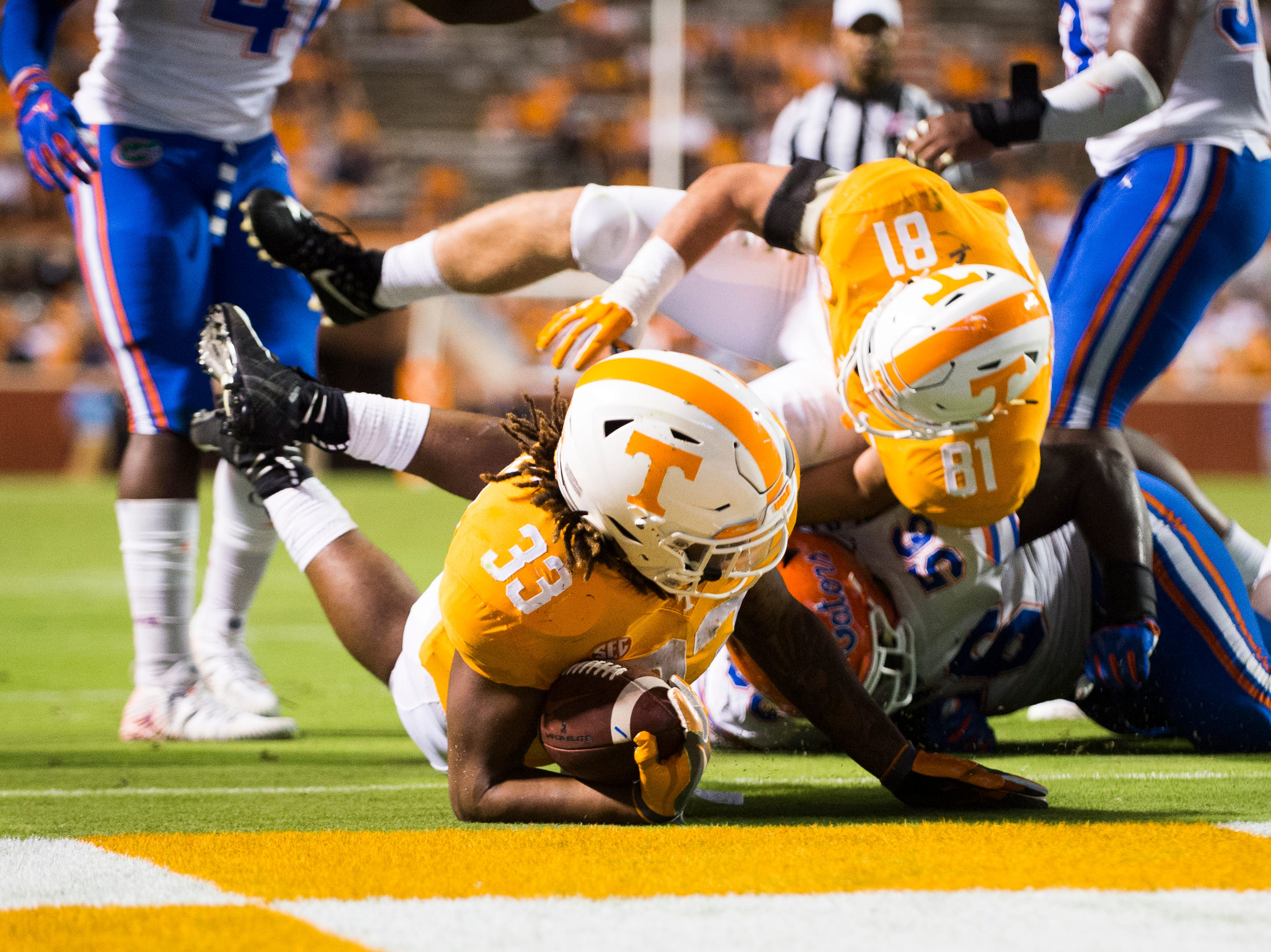 Tennessee running back Jeremy Banks (33)  lands in the end zone for a touchdown attempt during a game between Tennessee and Florida at Neyland Stadium in Knoxville, Tennessee on Saturday, September 22, 2018.