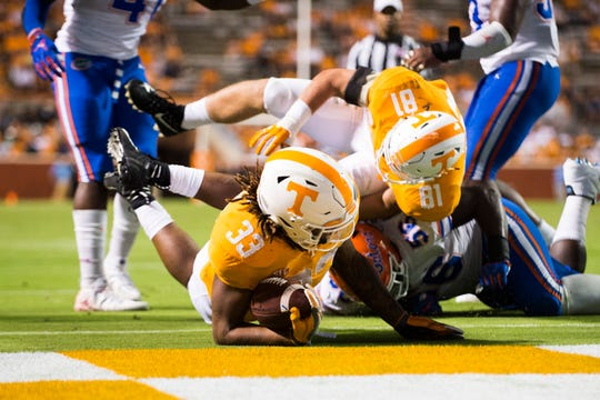 Tennessee freshman running back Jeremy Banks tumbles into the end zone for a touchdown against Florida on Sept. 22 at Neyland Stadium.