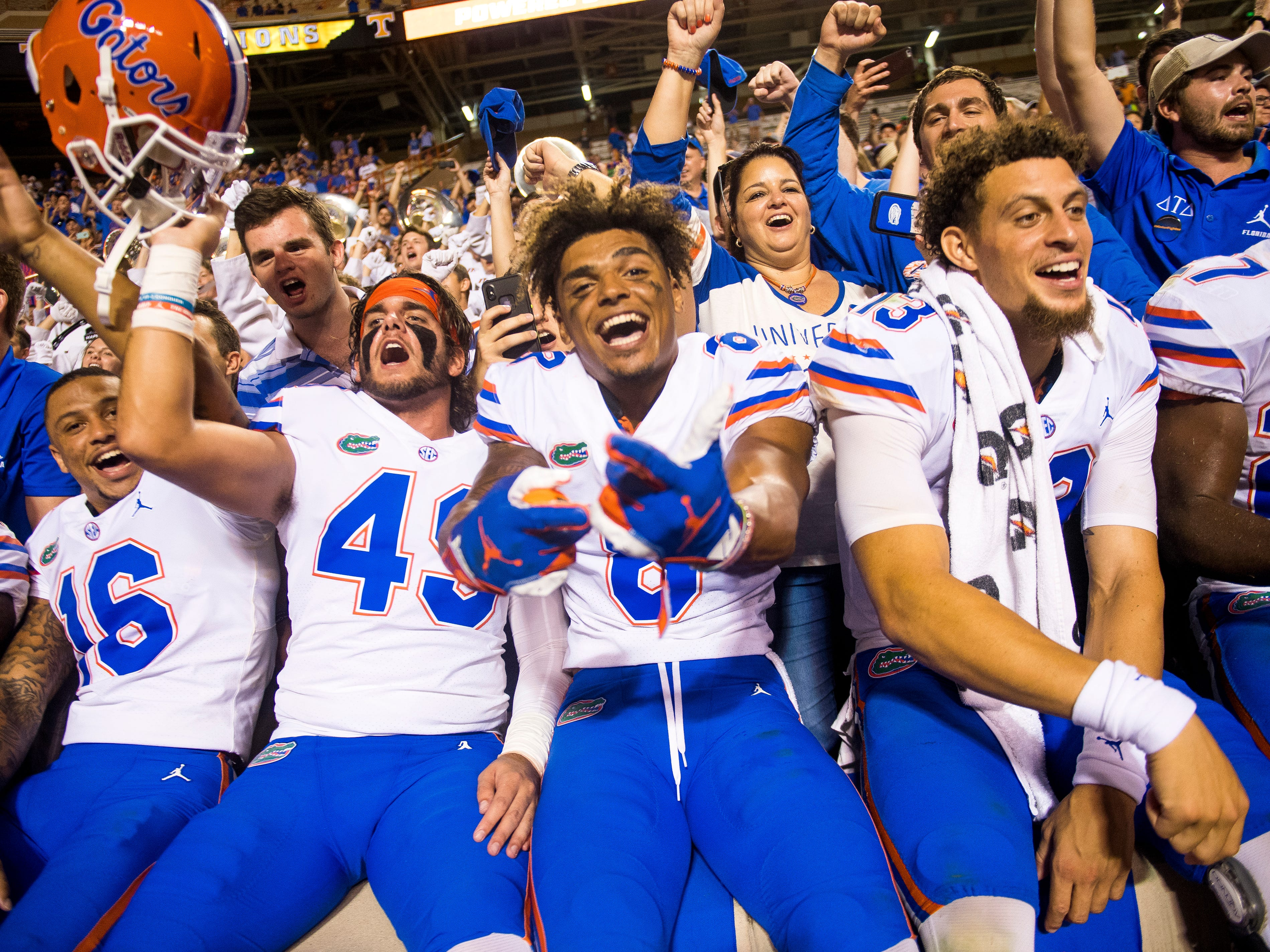 Florida long snapper Jacob Tilghman (49), Florida wide receiver Trevon Grimes (8) and Florida quarterback Feleipe Franks (13) celebrate after their 47-21 victory against Tennessee in Neyland Stadium on Saturday, Sept. 22, 2018.