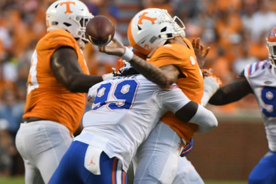 Tennessee quarterback Jarrett Guarantano (2) is sacked by Florida defensive lineman Jachai Polite (99) during a game between Tennessee and Florida at Neyland Stadium in Knoxville, Tennessee on Saturday, September 22, 2018.
