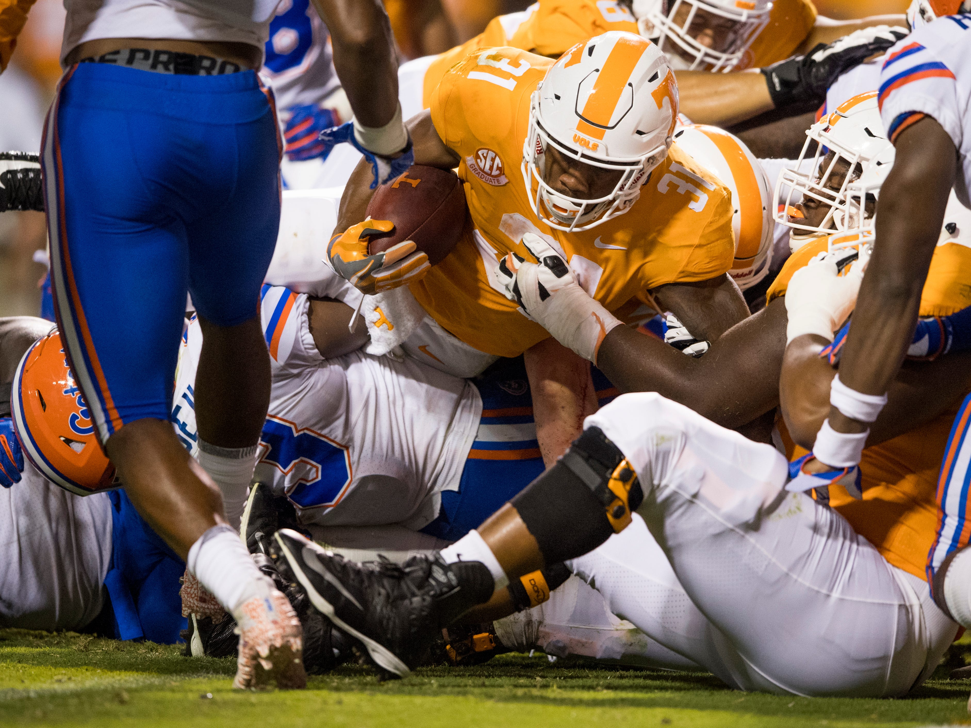 Tennessee running back Madre London (31) scores a touchdown during the Tennessee Volunteers' game against Florida in Neyland Stadium on Saturday, Sept. 22, 2018.