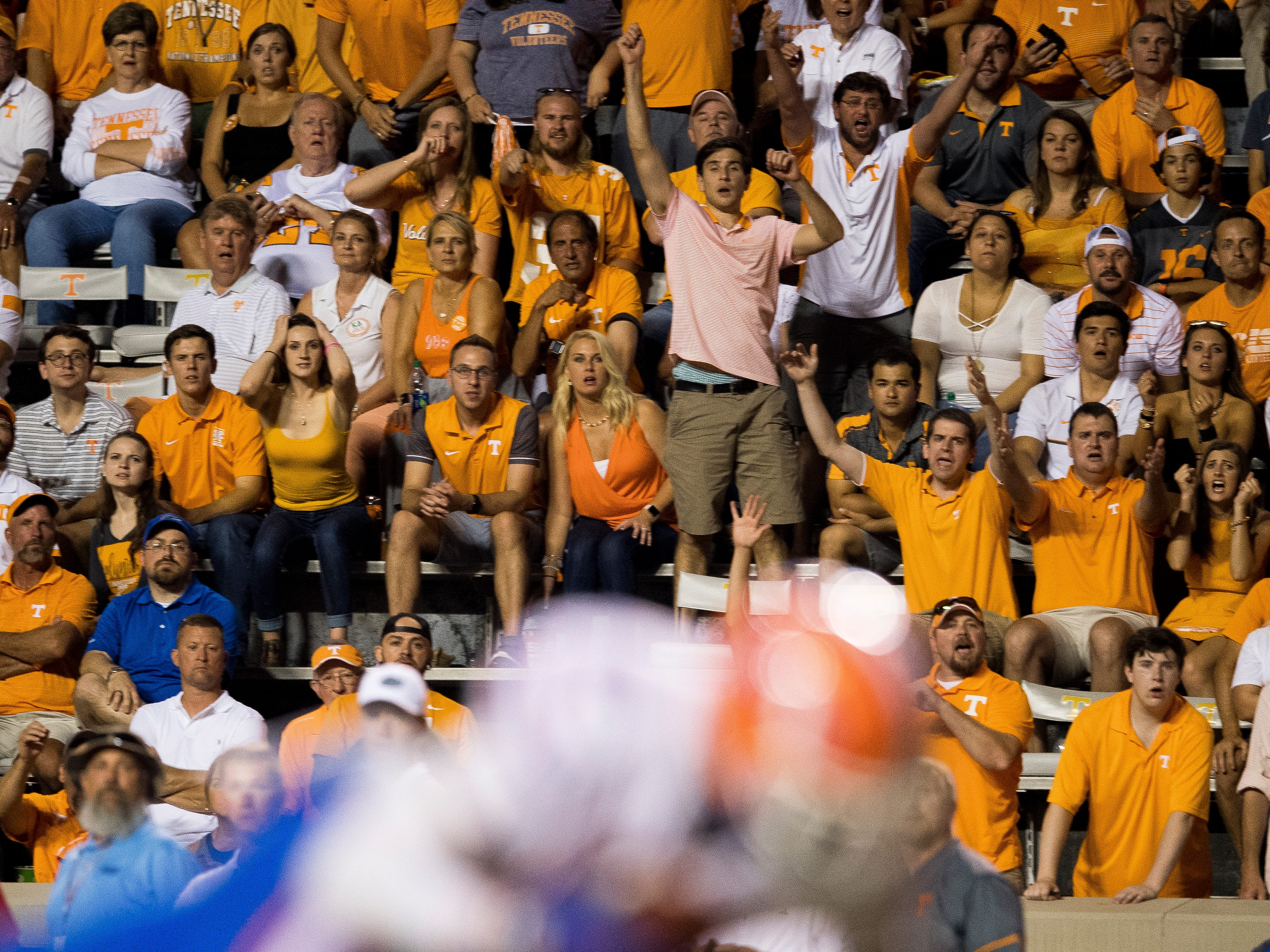 Tennessee fans react after a pass intended for Tennessee wide receiver Brandon Johnson (7) is intercepted by Florida defensive back Brad Stewart, Jr. (2) during the Tennessee Volunteers' game against Florida in Neyland Stadium on Saturday, Sept. 22, 2018. The interception was Tennessee quarterback Jarrett Guarantano's second interception and the Vols' sixth turnover of the game.