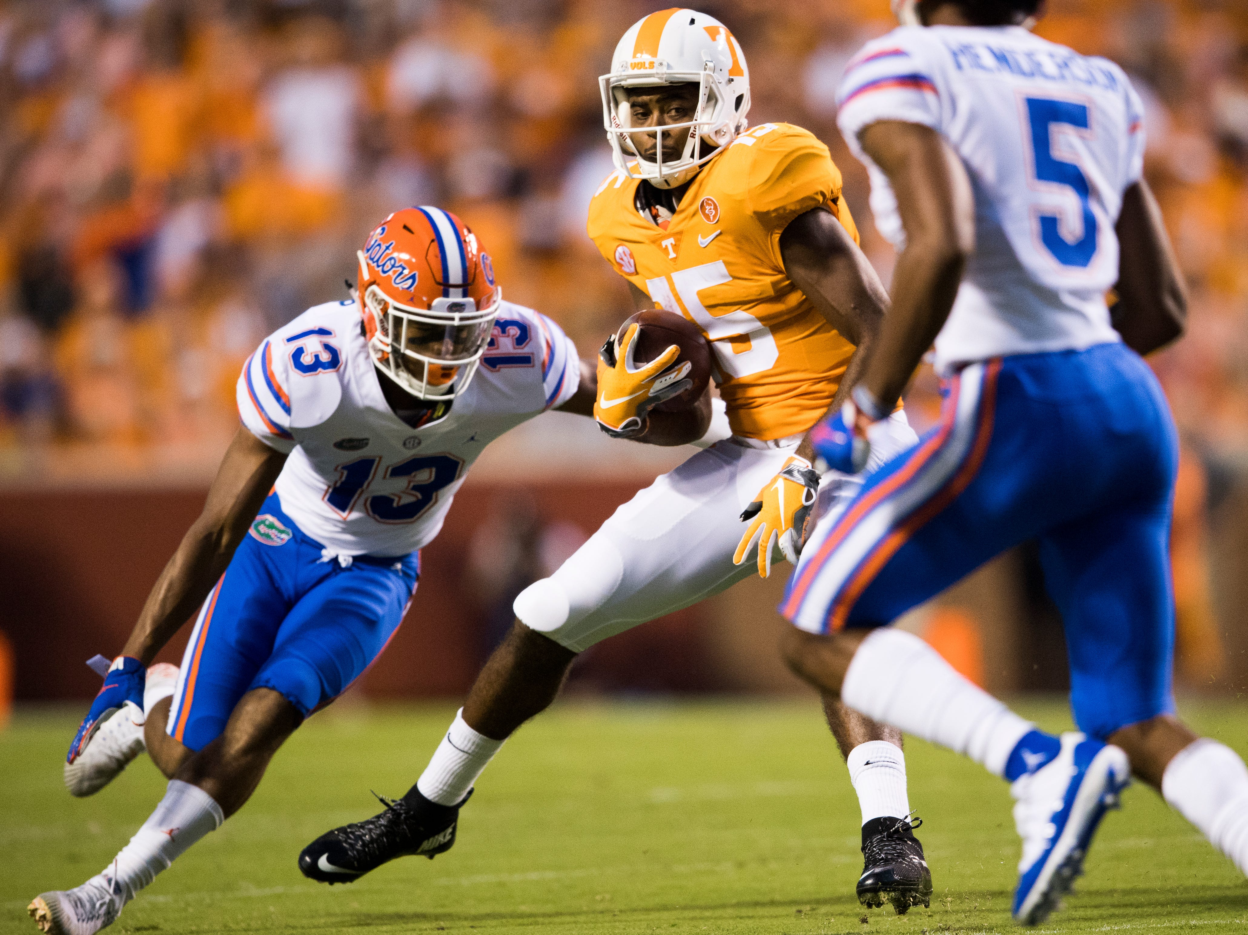 Tennessee wide receiver Jauan Jennings (15) looks to run past Florida safety Donovan Stiner (13) and  Florida defensive back CJ Henderson (5) during a game between Tennessee and Florida at Neyland Stadium in Knoxville, Tennessee on Saturday, September 22, 2018.