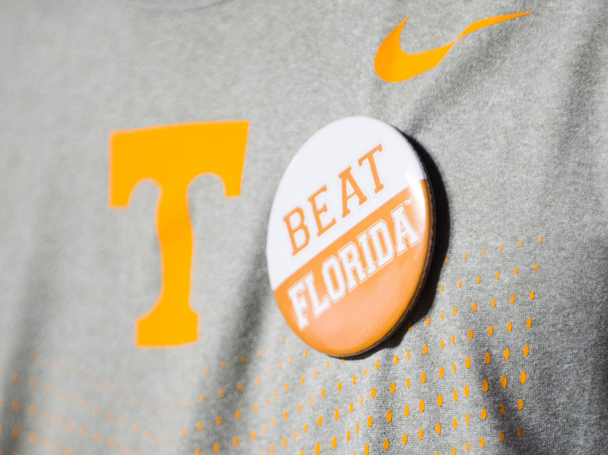 """A fan wears a """"Beat Florida"""" pin during a game between Tennessee and Florida at Neyland Stadium in Knoxville, Tennessee on Saturday, September 22, 2018."""