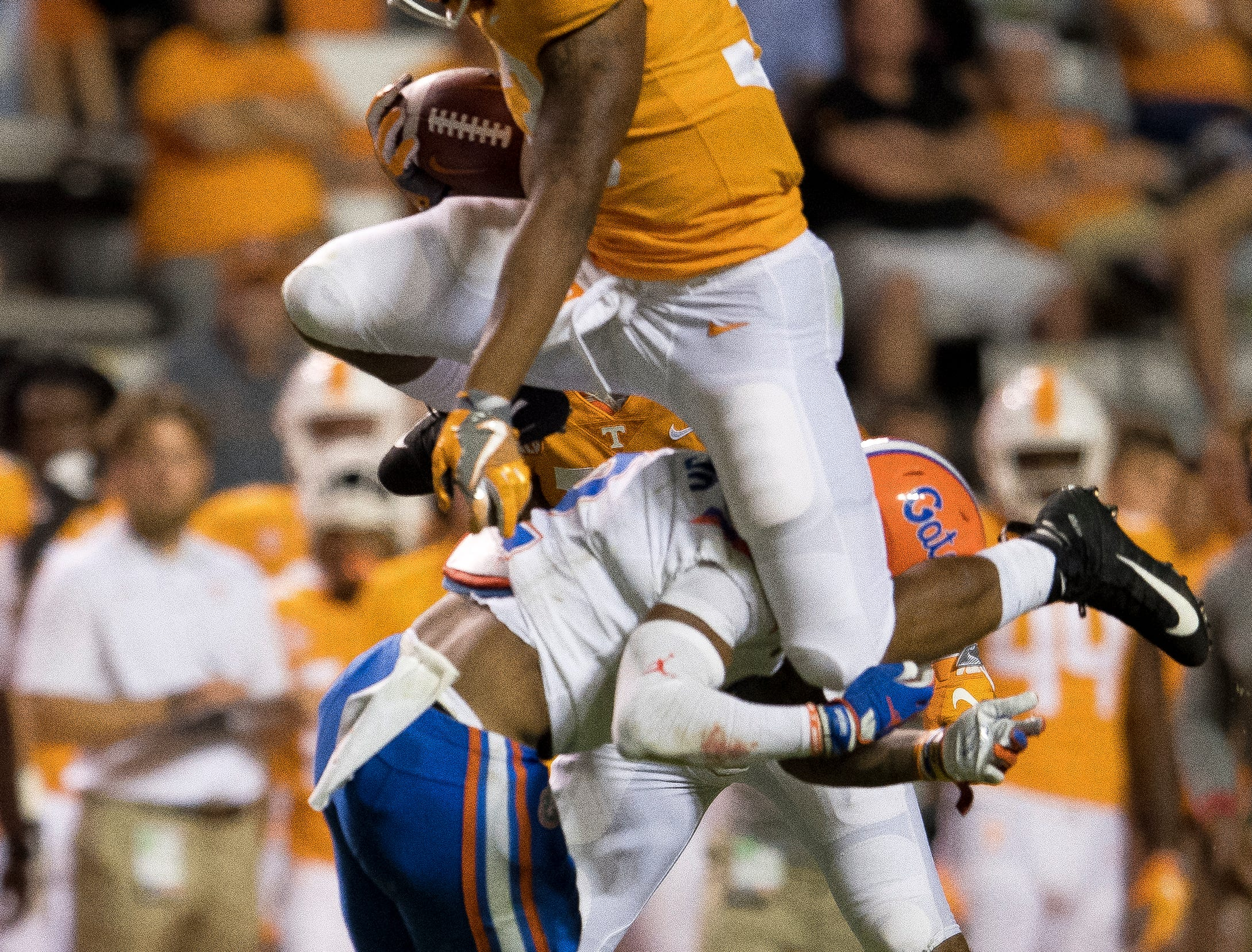 Tennessee running back Jeremy Banks (33) leaps over a Florida defender during the Tennessee Volunteers' game against Florida in Neyland Stadium on Saturday, Sept. 22, 2018.