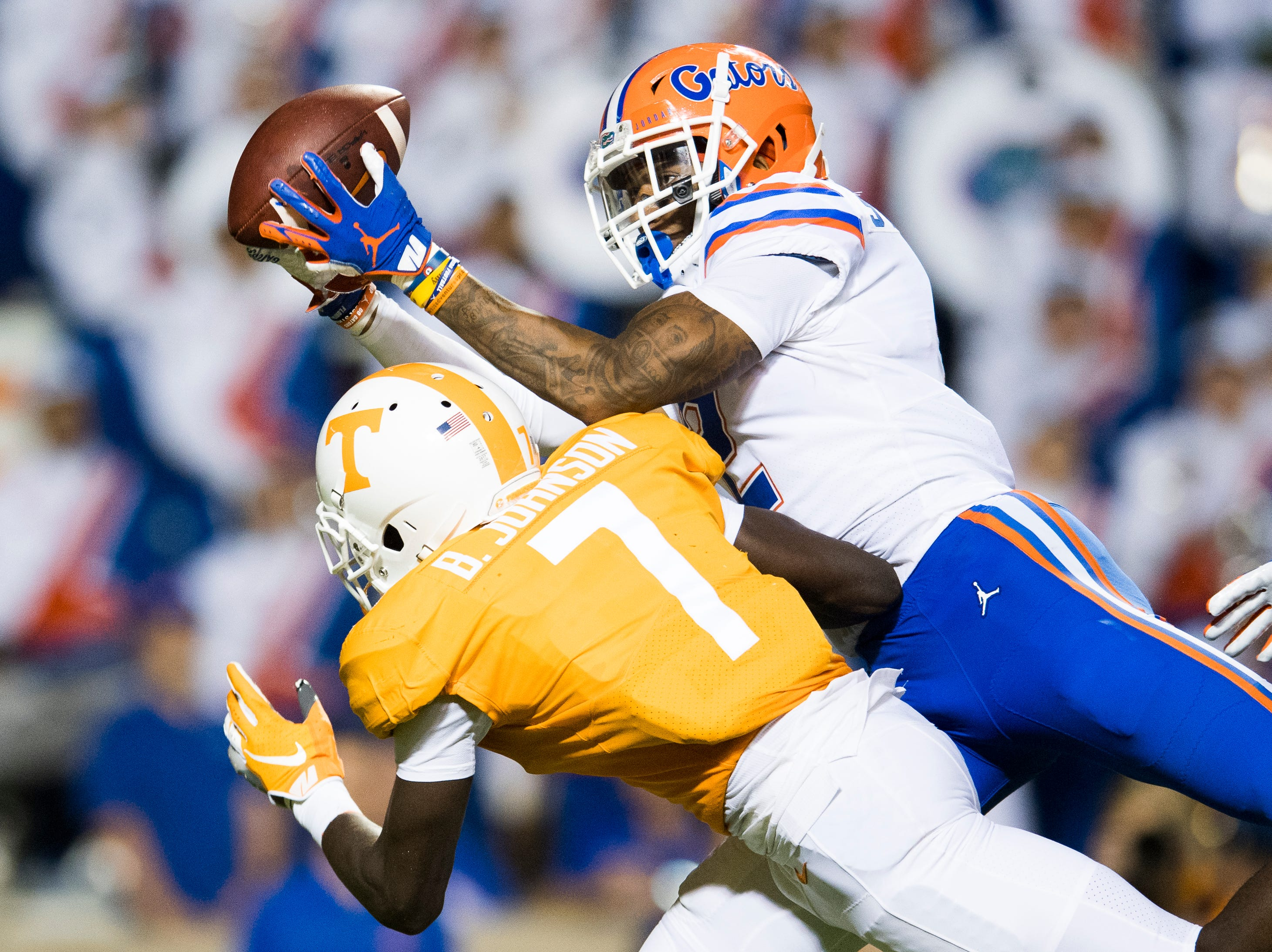Florida defensive back Brad Stewart, Jr. (2) intercepts a pass intended for Tennessee wide receiver Brandon Johnson (7) during a game between Tennessee and Florida at Neyland Stadium in Knoxville, Tennessee on Saturday, September 22, 2018.