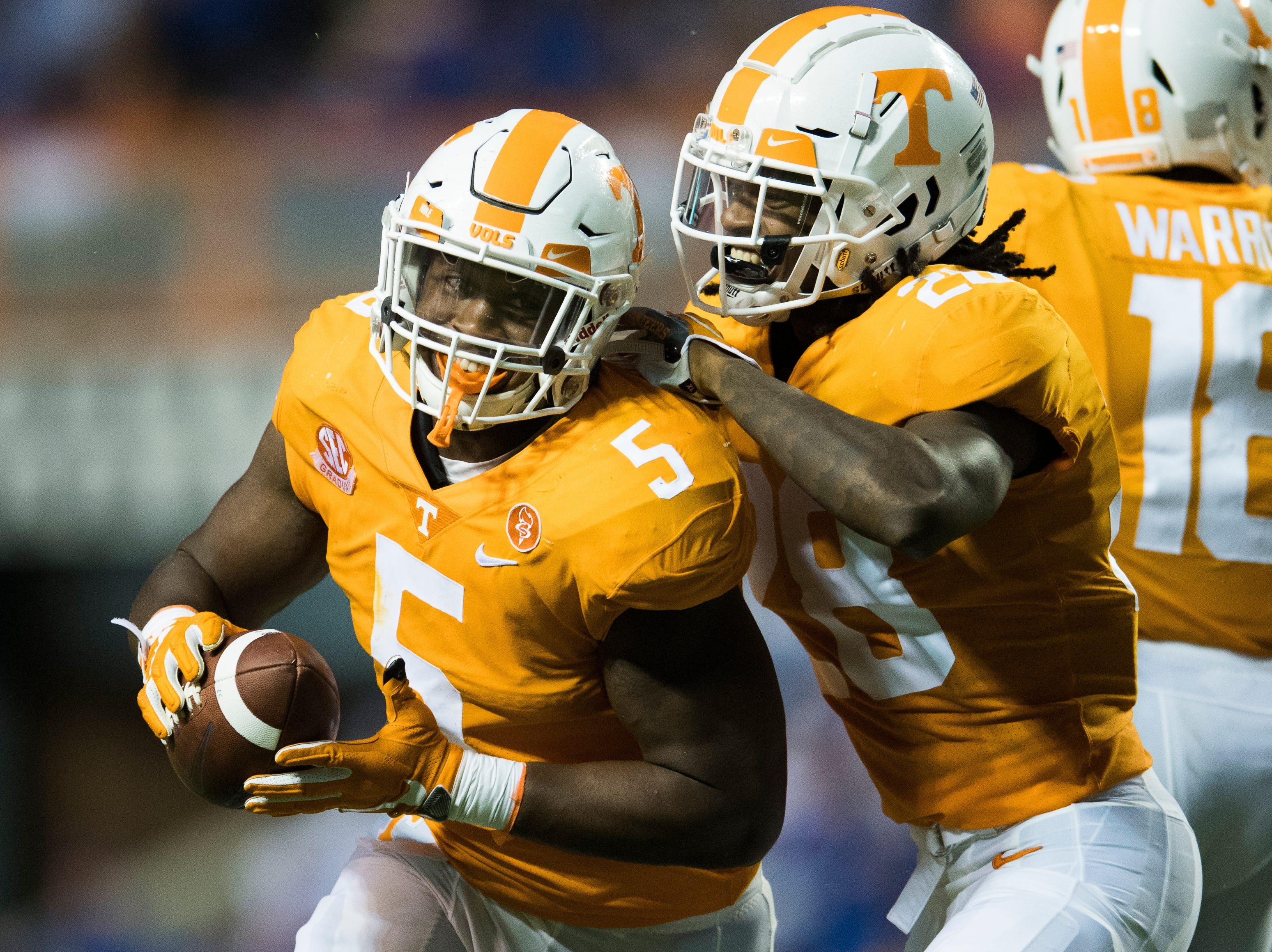 Tennessee defensive lineman Kyle Phillips (5) is congratulated by Tennessee defensive back Baylen Buchanan (28) after regaining possession of the ball during a game between Tennessee and Florida at Neyland Stadium in Knoxville, Tennessee on Saturday, September 22, 2018.