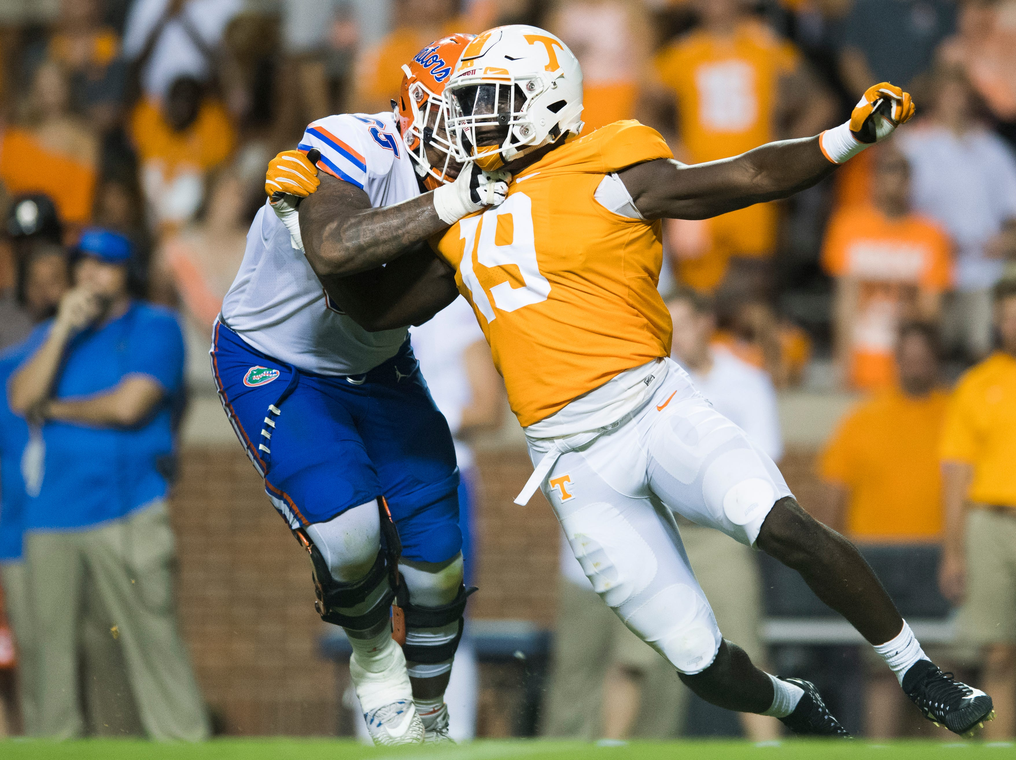 Tennessee linebacker Darrell Taylor (19) works around Florida offensive lineman Jawaan Taylor (65) during a game between Tennessee and Florida at Neyland Stadium in Knoxville, Tennessee on Saturday, September 22, 2018.