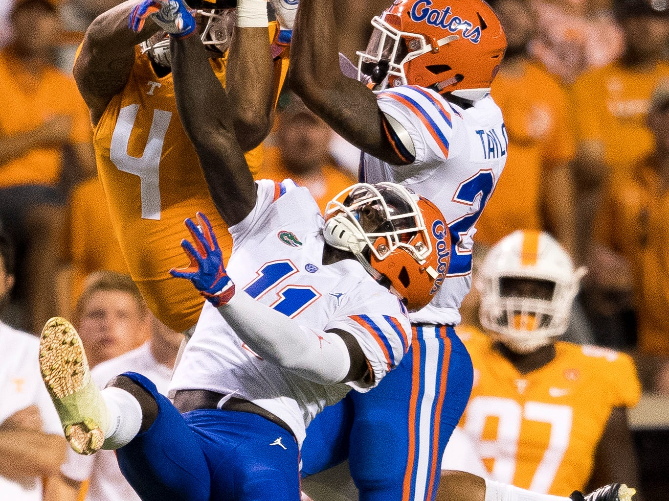 A pass intended for Tennessee tight end Dominick Wood-Anderson (4) is nearly intercepted by Florida defensive back Jeawon Taylor (29) and Florida linebacker Vosean Joseph (11) during the Tennessee Volunteers' game against Florida in Neyland Stadium on Saturday, Sept. 22, 2018.