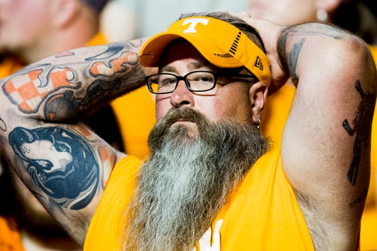 A Tennessee fan watches the game in dismay during a game between Tennessee and Florida at Neyland Stadium in Knoxville, Tennessee on Saturday, September 22, 2018.