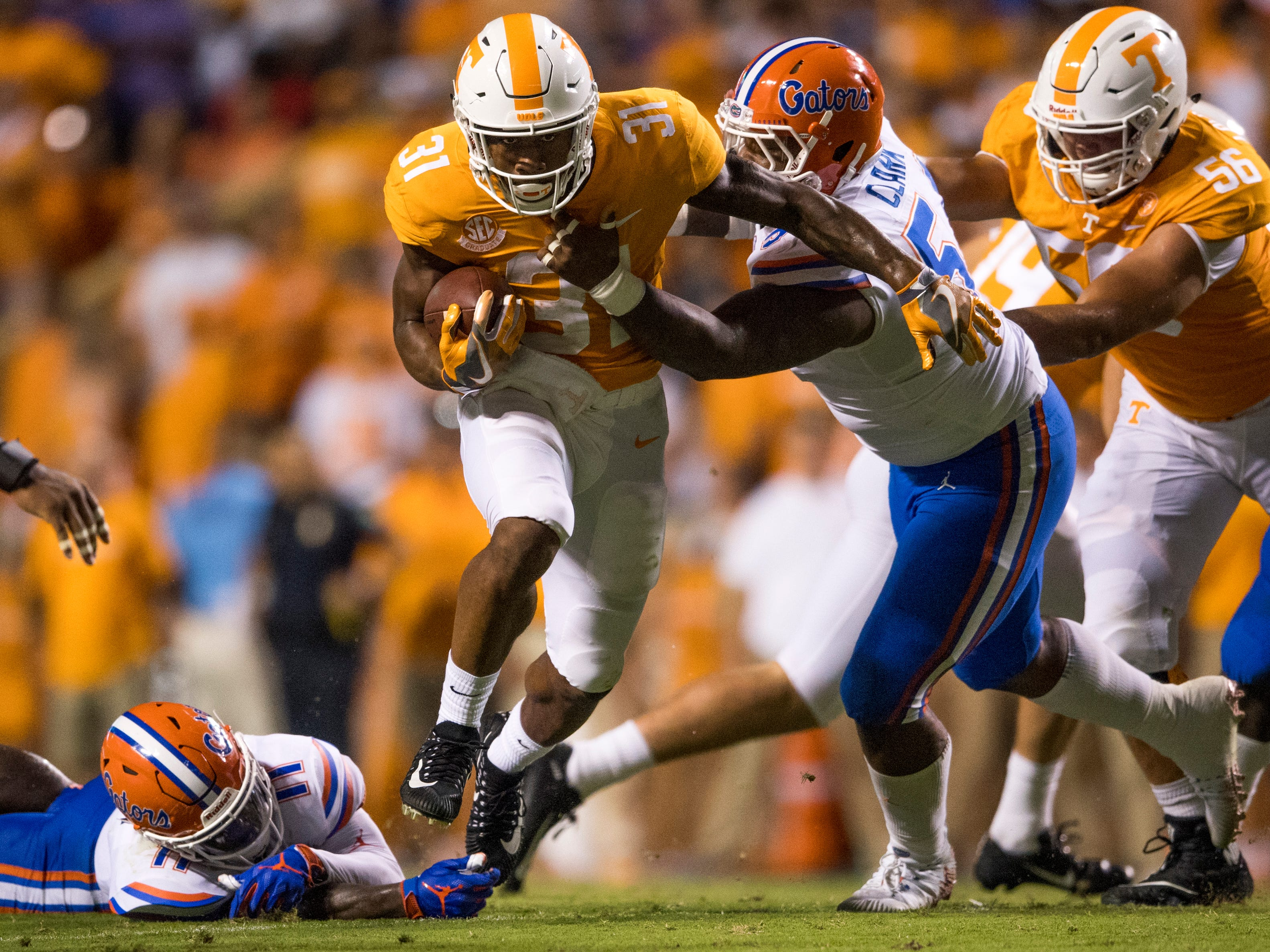Tennessee running back Madre London (31) fights for yards during the Tennessee Volunteers' game against Florida in Neyland Stadium on Saturday, Sept. 22, 2018.