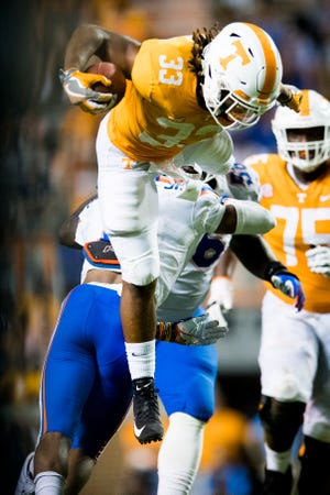 Tennessee running back Jeremy Banks (33) leaps over Florida defensive back Brad Stewart, Jr. (2) during a game between Tennessee and Florida at Neyland Stadium in Knoxville, Tennessee on Saturday, September 22, 2018.