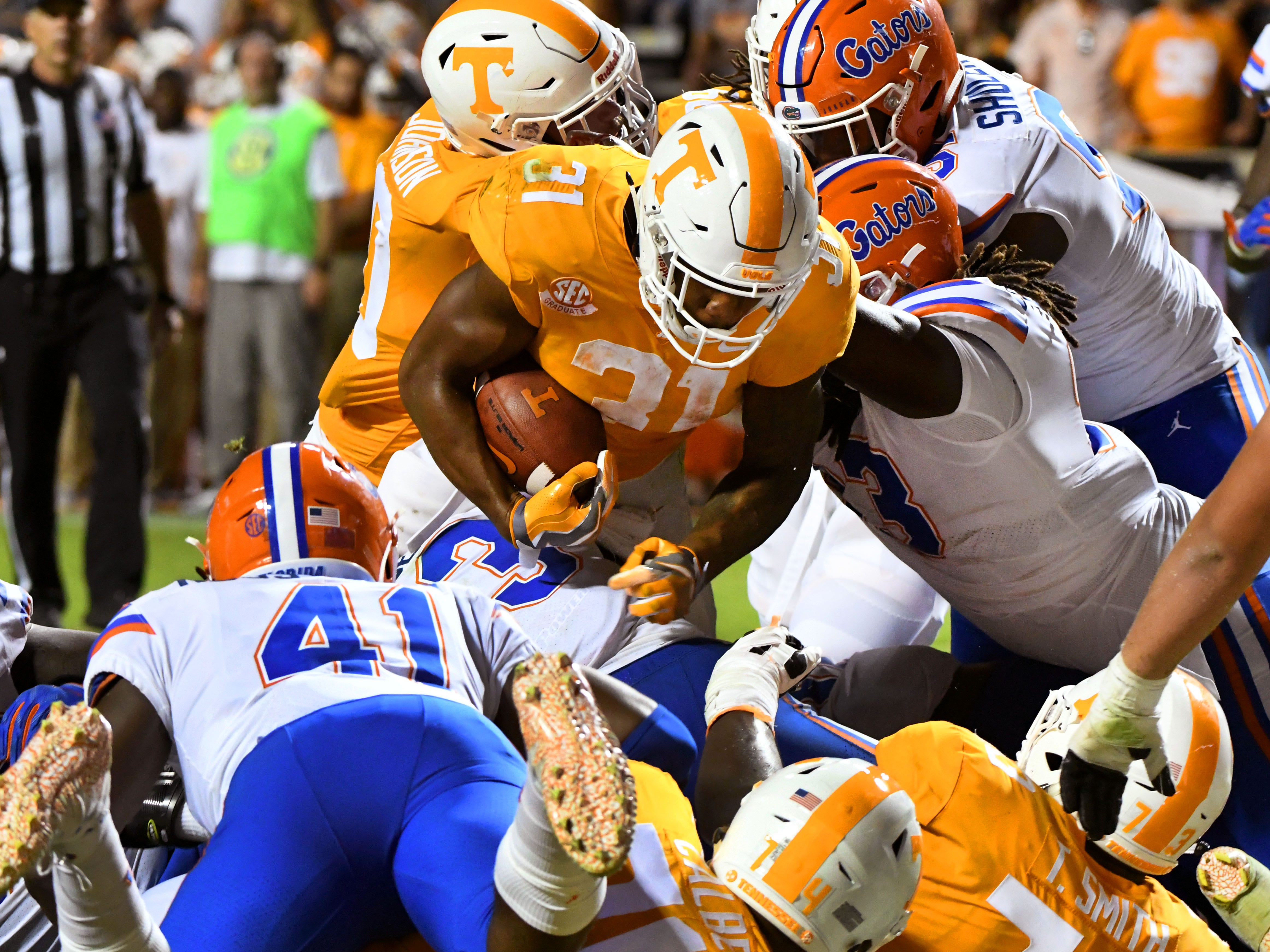 Tennessee running back Madre London (31) scores a touchdown during second half of their 47-21 loss to Florida in Neyland Stadium Saturday, September 22, 2018 in Knoxville, Tenn.