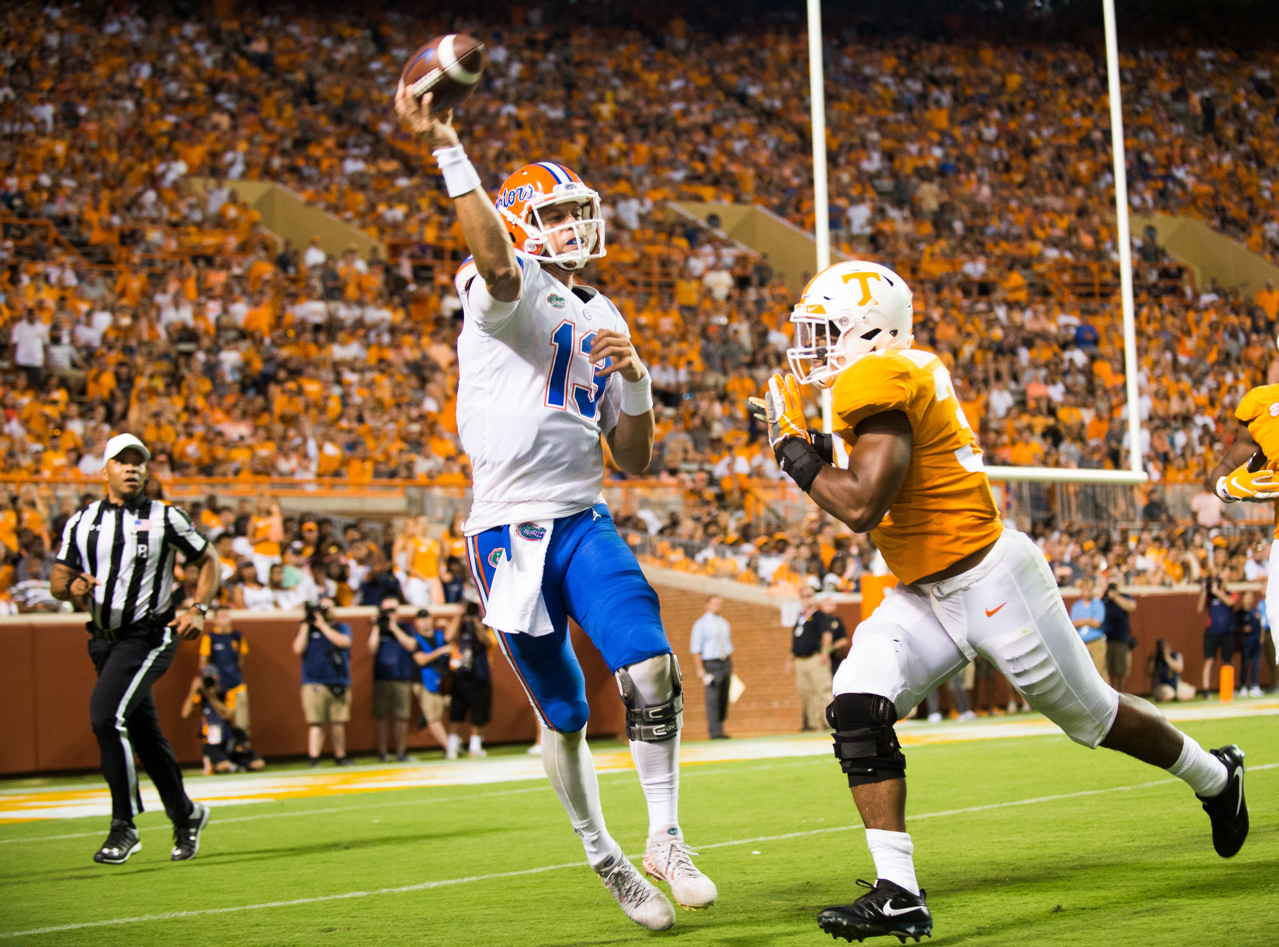 Florida quarterback Feleipe Franks (13)  throws a pass as Tennessee linebacker Darrin Kirkland Jr. (34) defends during a game between Tennessee and Florida at Neyland Stadium in Knoxville, Tennessee on Saturday, September 22, 2018.