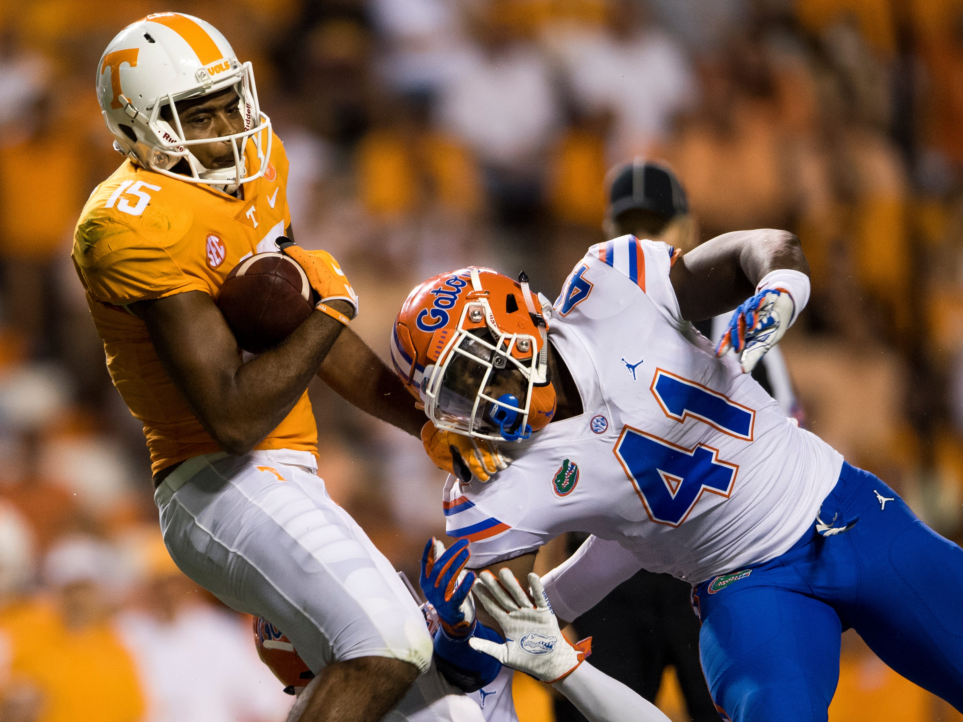 Tennessee wide receiver Jauan Jennings (15) fights for extra yards after catching a pass during the Tennessee Volunteers' game against Florida in Neyland Stadium on Saturday, Sept. 22, 2018.
