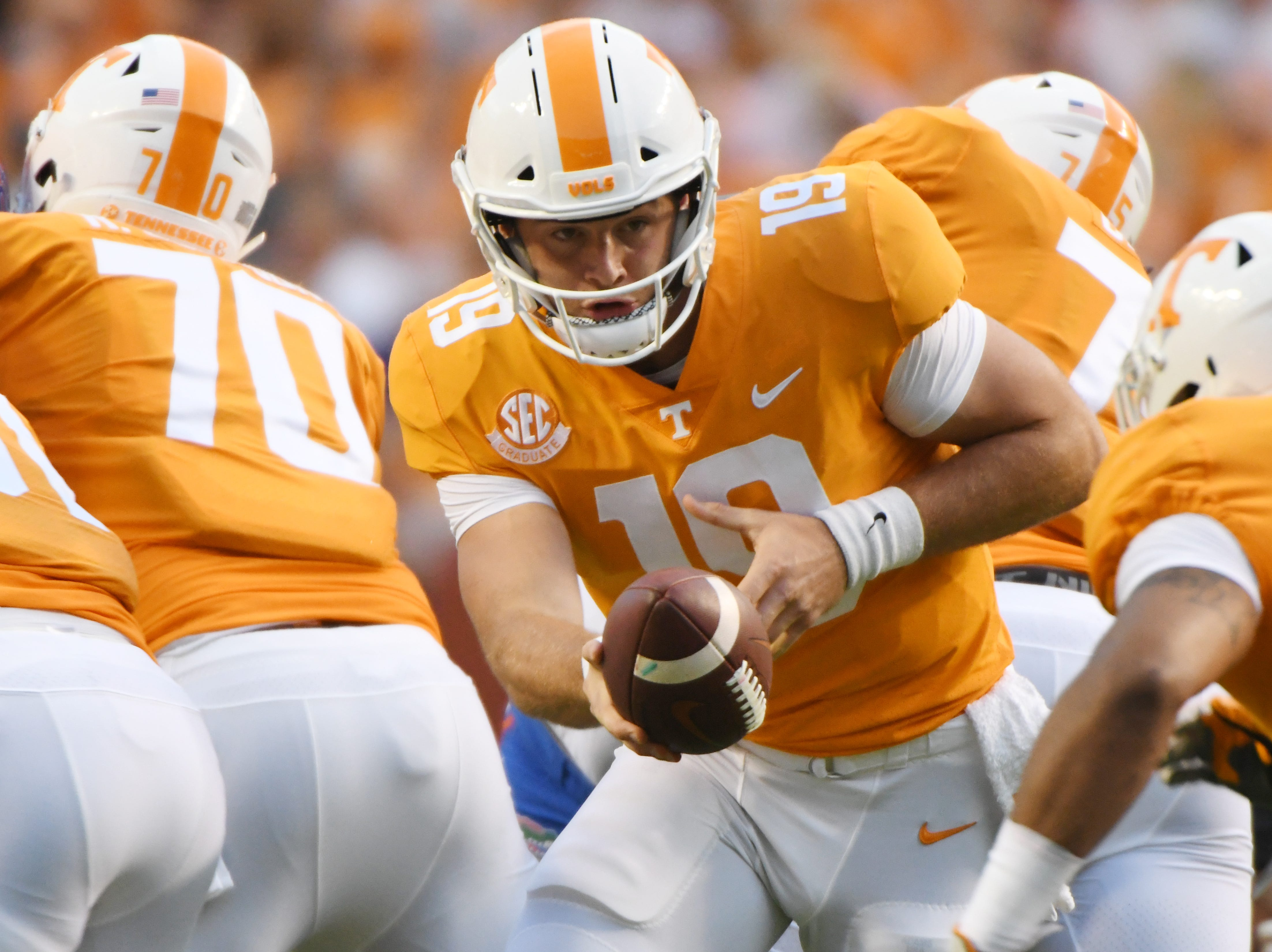Tennessee quarterback Keller Chryst (19) hands off the ball during a game between Tennessee and Florida at Neyland Stadium in Knoxville, Tennessee on Saturday, September 22, 2018.
