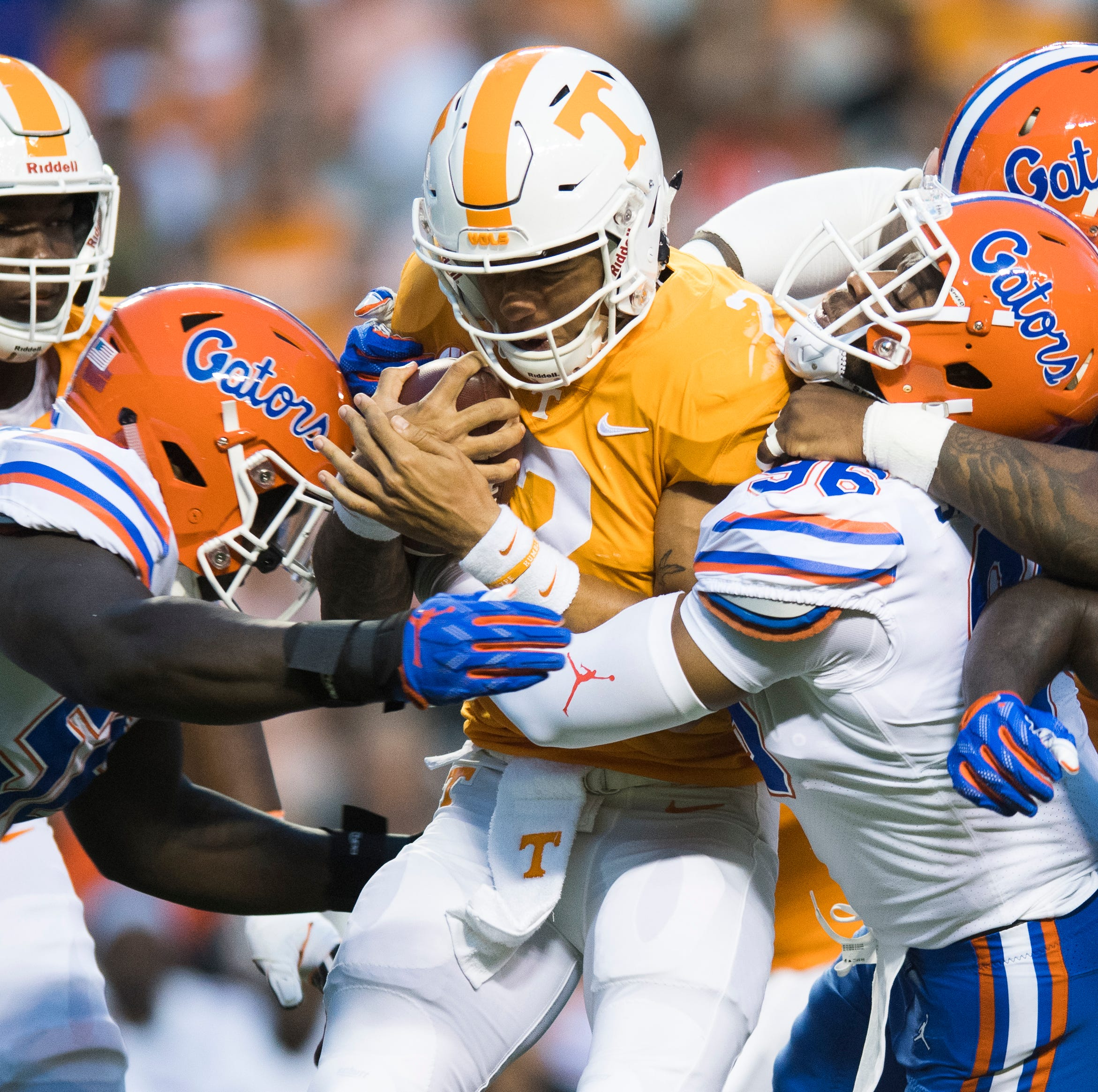Tennessee quarterback Jarrett Guarantano (2) is tackled by a host of Florida players during a game between Tennessee and Florida at Neyland Stadium in Knoxville, Tennessee on Saturday, September 22, 2018.