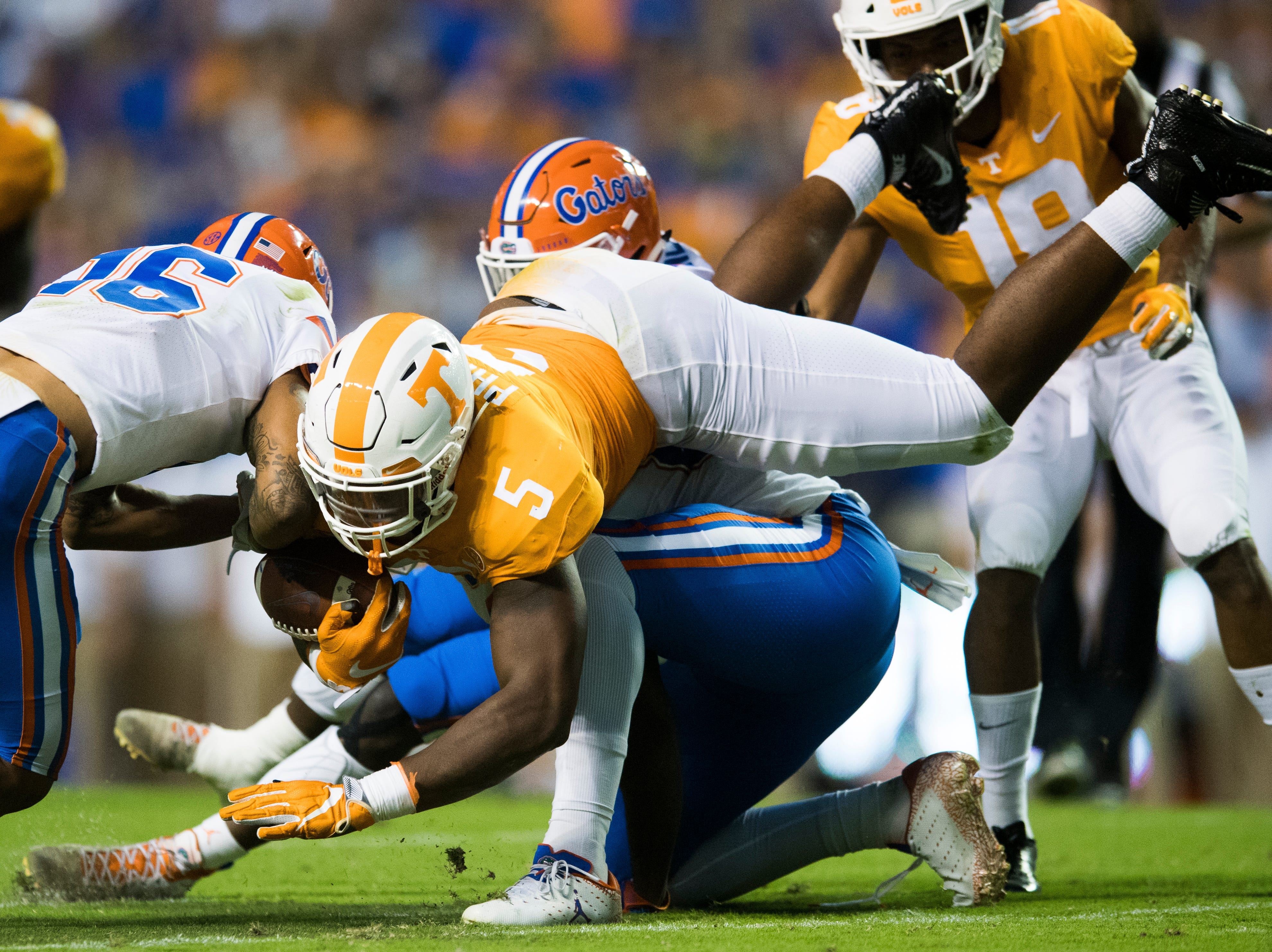 Tennessee defensive lineman Kyle Phillips (5) slides over Florida tight end Kemore Gamble (88) during a game between Tennessee and Florida at Neyland Stadium in Knoxville, Tennessee on Saturday, September 22, 2018.