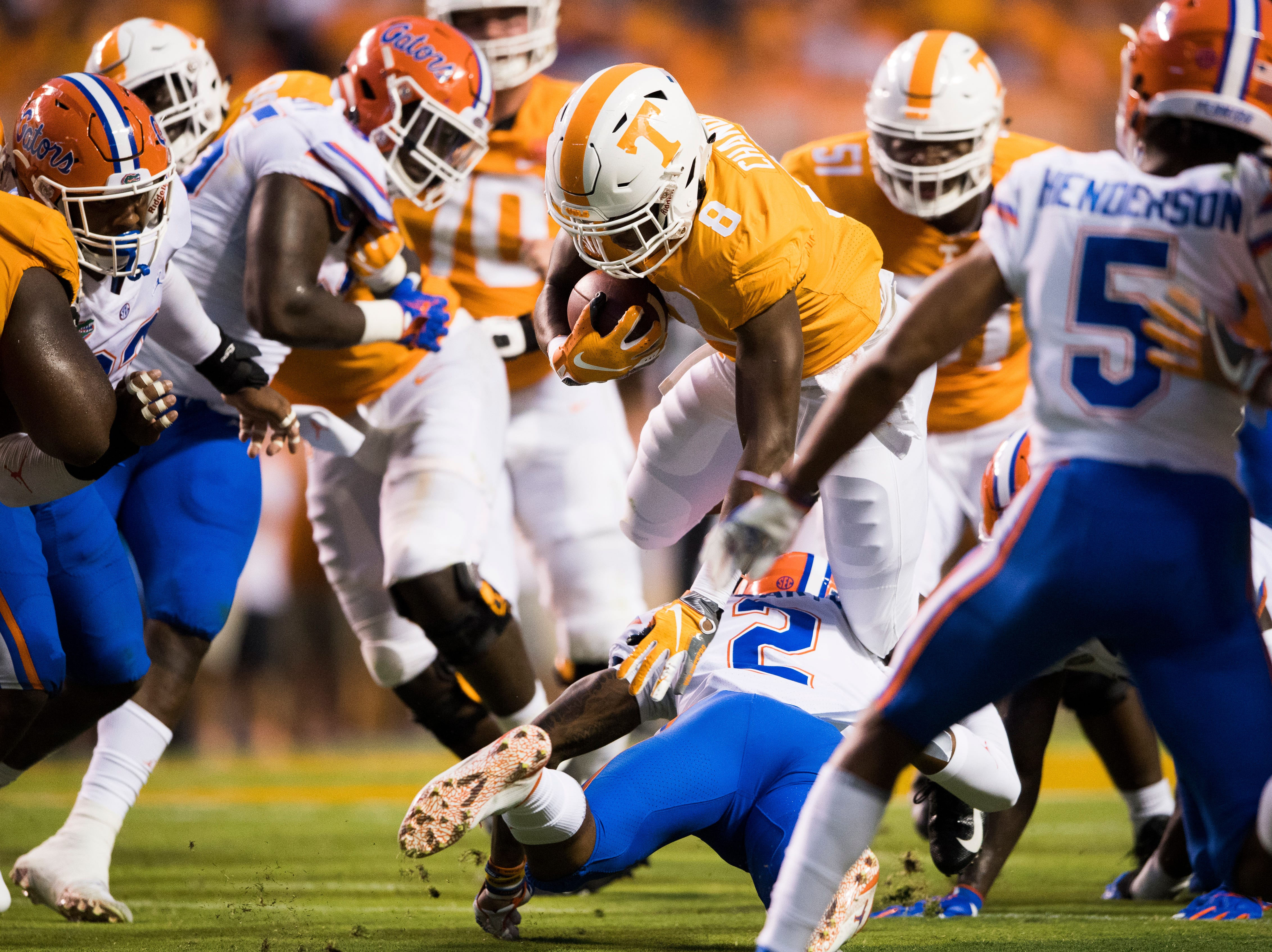 Tennessee running back Ty Chandler (8) leaps over Florida defensive back Brad Stewart, Jr. (2) during a game between Tennessee and Florida at Neyland Stadium in Knoxville, Tennessee on Saturday, September 22, 2018.
