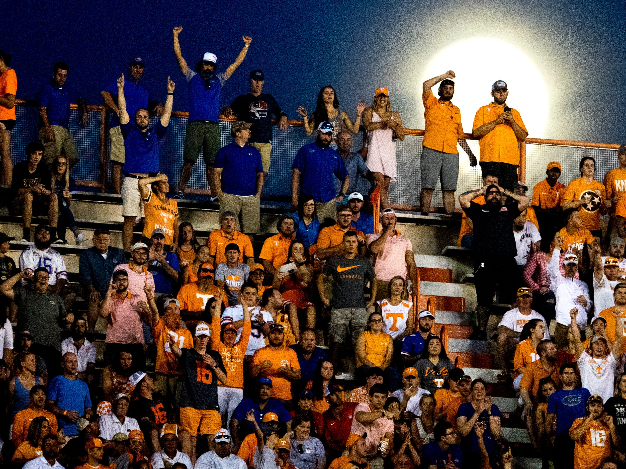 Fans cheer in the stands as the moon rises in the sky during a game between Tennessee and Florida at Neyland Stadium in Knoxville, Tennessee on Saturday, September 22, 2018.