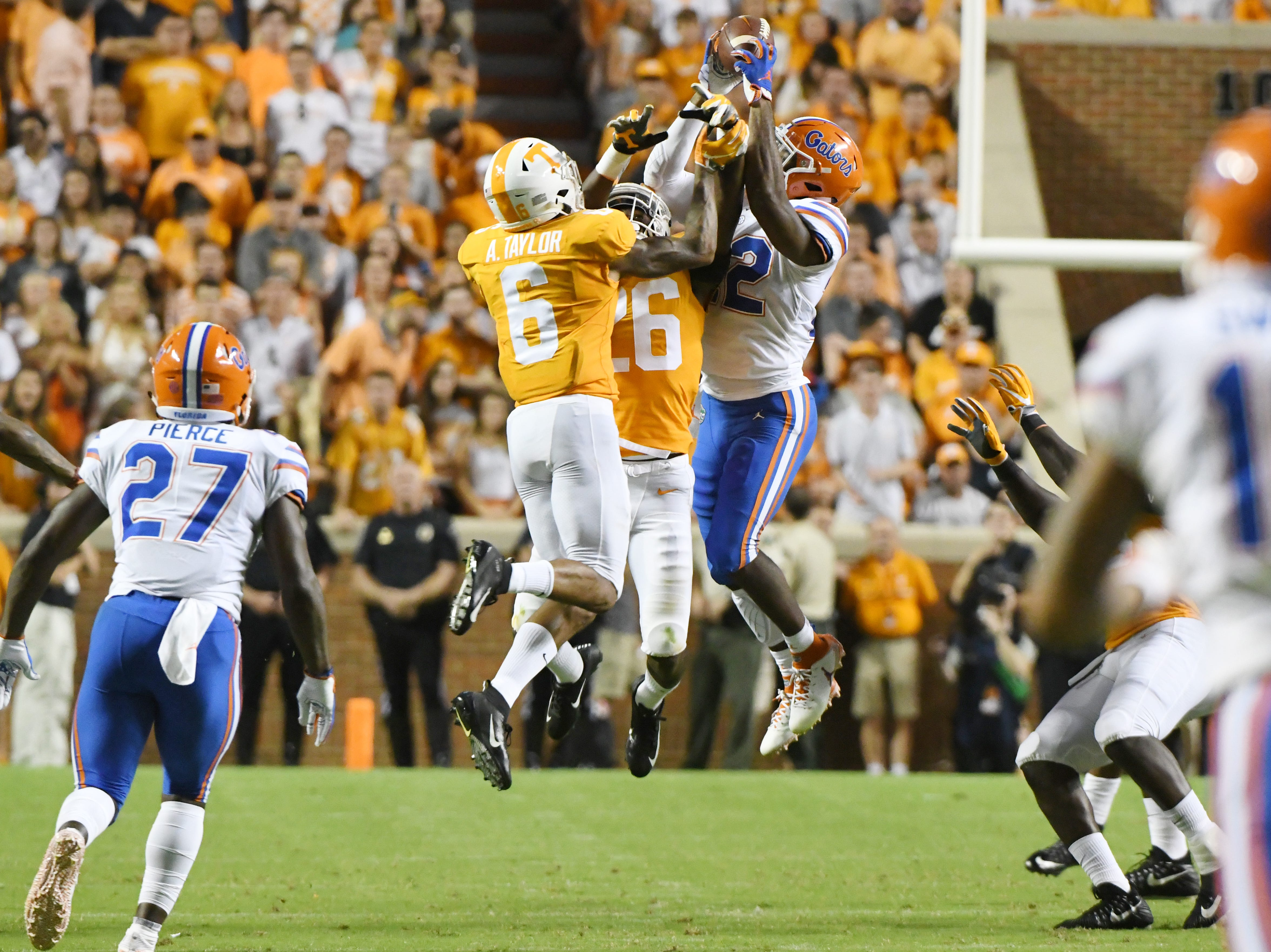 Tennessee defensive back/wide receiver Alontae Taylor (6) Tennessee wide receiver Jay Shoop (26) and Florida running back Lamical Perine (22) go for a pass during a game between Tennessee and Florida at Neyland Stadium in Knoxville, Tennessee on Saturday, September 22, 2018.