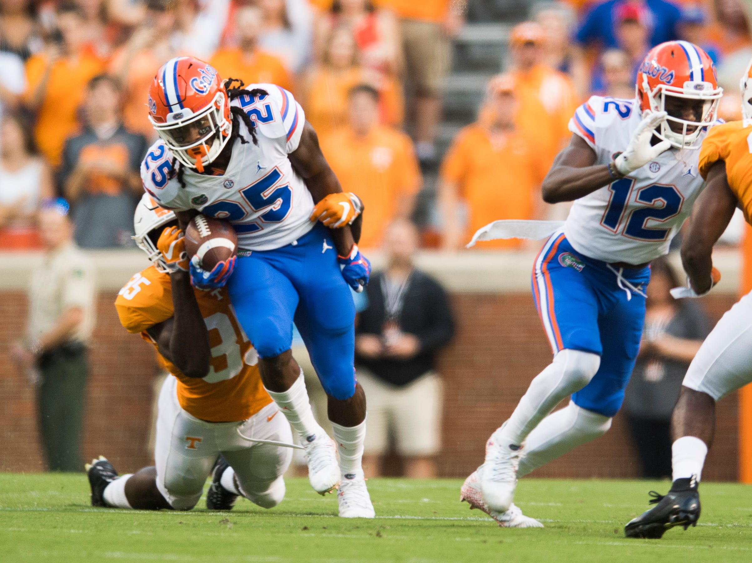 Tennessee linebacker Daniel Bituli (35) attacks Florida running back Jordan Scarlett (25) during a game between Tennessee and Florida at Neyland Stadium in Knoxville, Tennessee on Saturday, September 22, 2018.