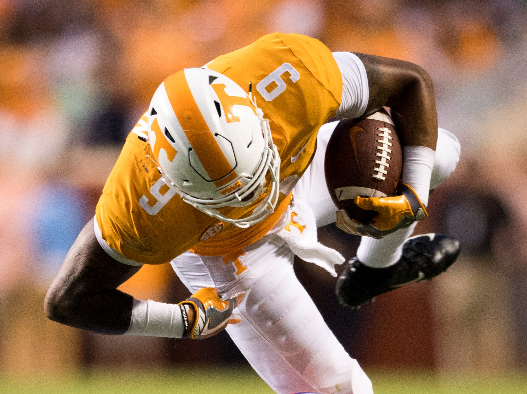 Tennessee running back Tim Jordan (9) tries to stay on his feet as Florida defensive back Chauncey Gardner-Johnson (23) tackles him during the Tennessee Volunteers' game against Florida in Neyland Stadium on Saturday, Sept. 22, 2018.