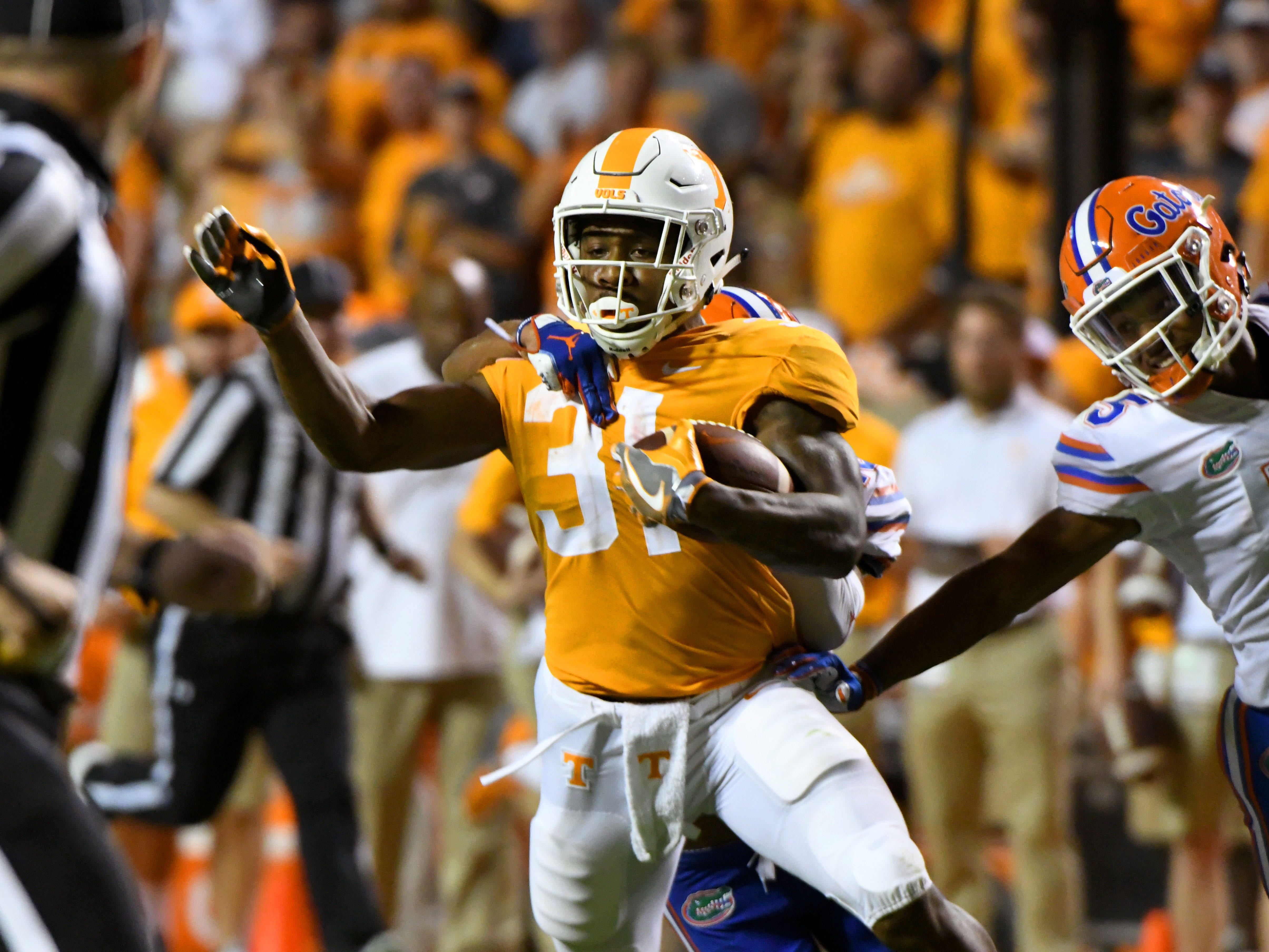 Tennessee running back Madre London (31) is tackled during second half of their 47-21 loss to Florida in Neyland Stadium Saturday, September 22, 2018 in Knoxville, Tenn.