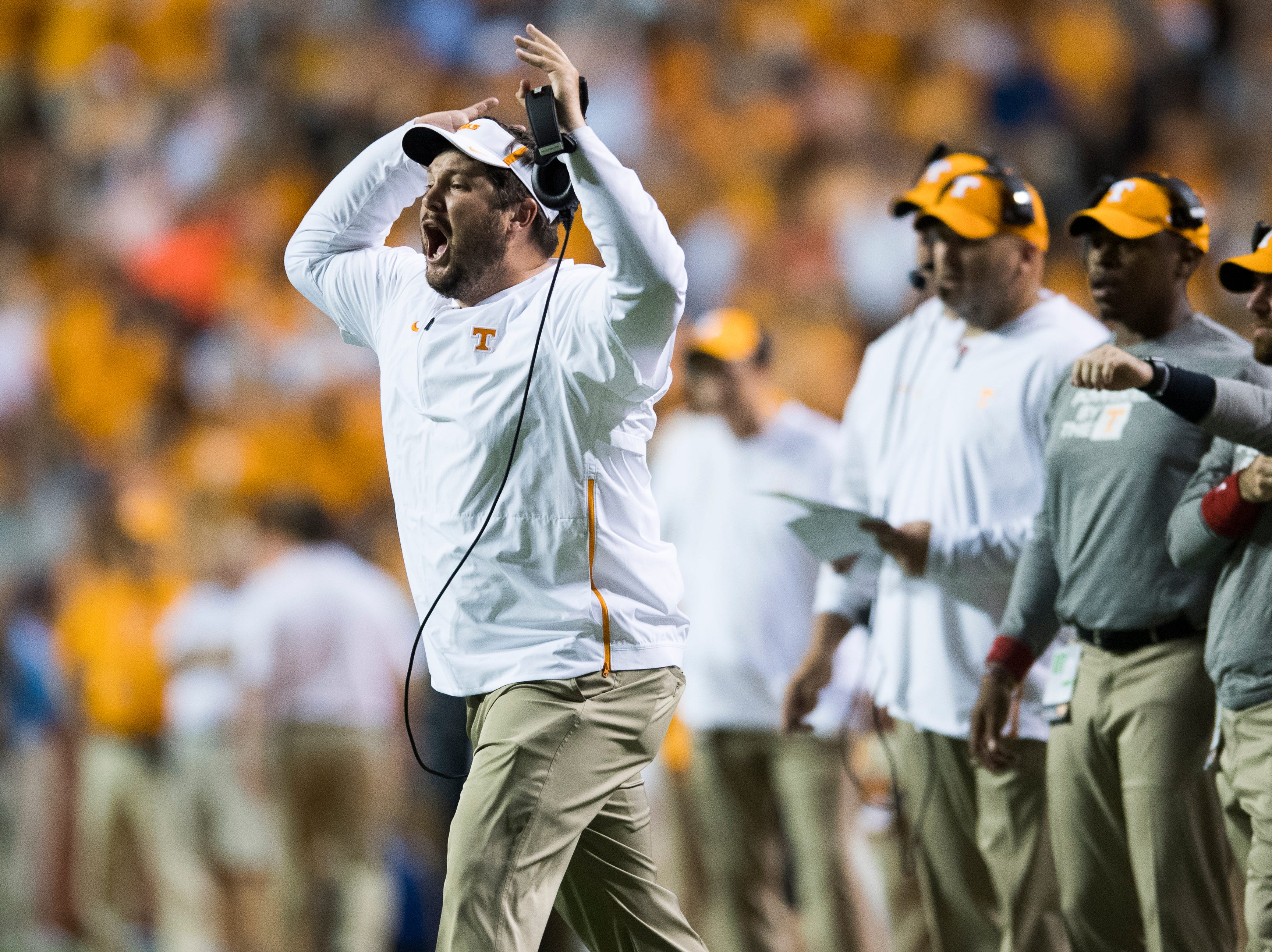 Tennessee tight ends coach Brian Niedermeyer calls from the sidelines during a game between Tennessee and Florida at Neyland Stadium in Knoxville, Tennessee on Saturday, September 22, 2018.