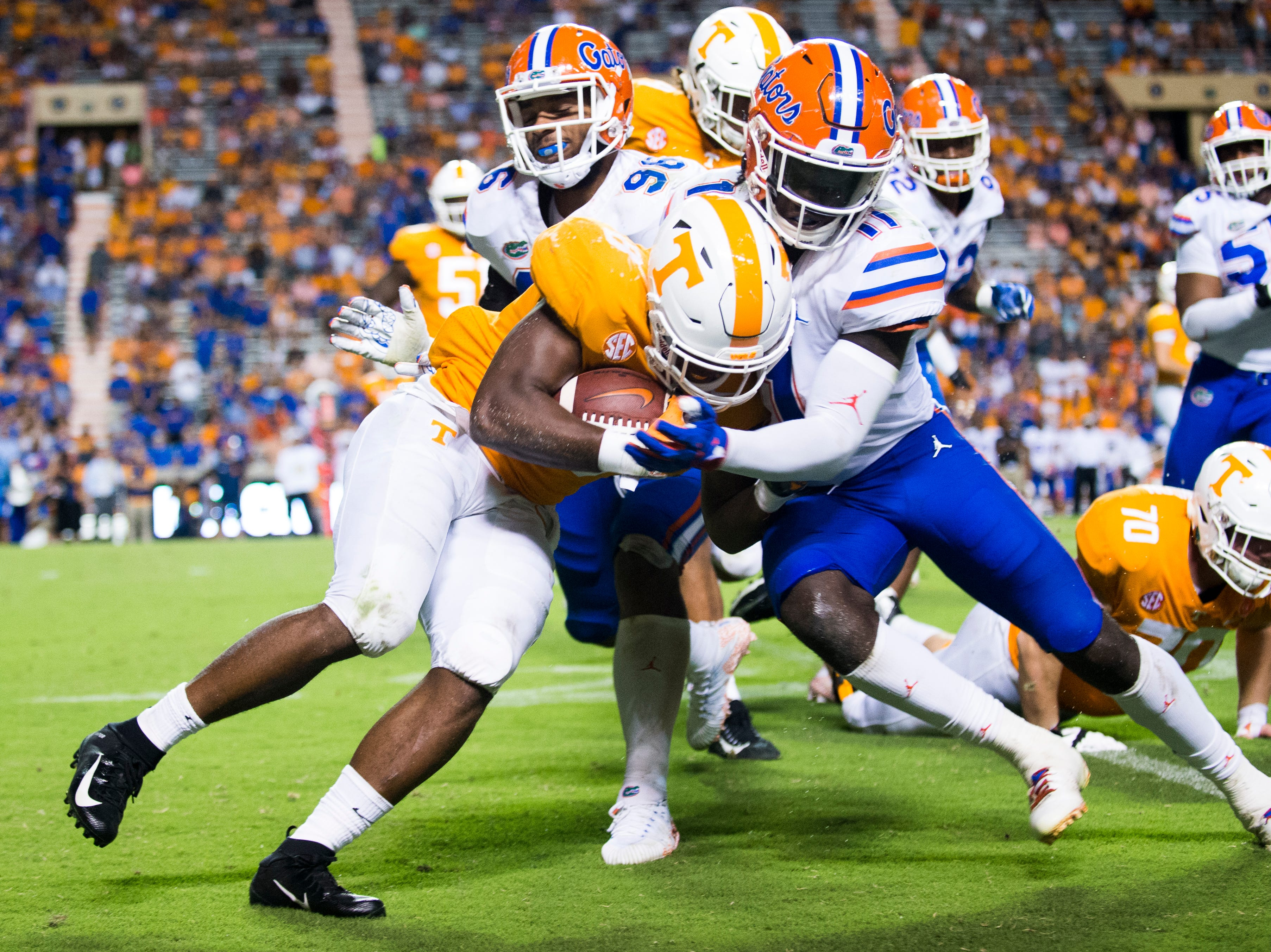 Tennessee running back Ty Chandler (8) is knocked out of bounds by Florida linebacker Vosean Joseph (11) during a game between Tennessee and Florida at Neyland Stadium in Knoxville, Tennessee on Saturday, September 22, 2018.