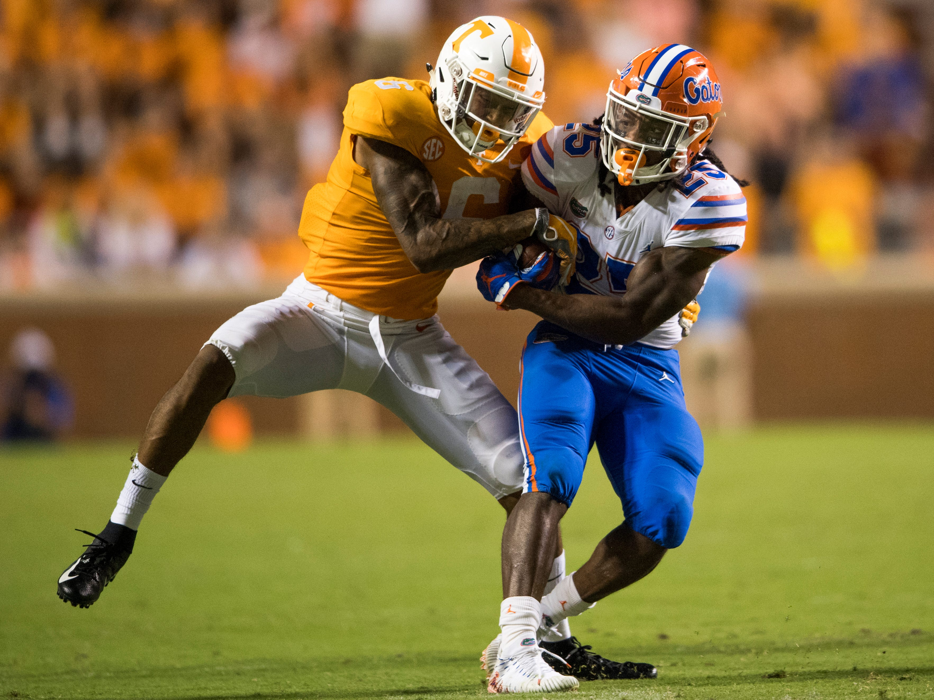 Tennessee defensive back/wide receiver Alontae Taylor (6) takes down Florida running back Jordan Scarlett (25)  during the Tennessee Volunteers' game against Florida in Neyland Stadium on Saturday, Sept. 22, 2018.