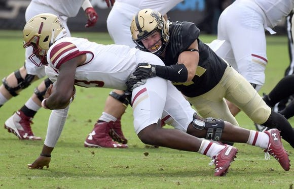 Purdue safety Jacob Thieneman sacks Boston College quarterback Anthony Brown