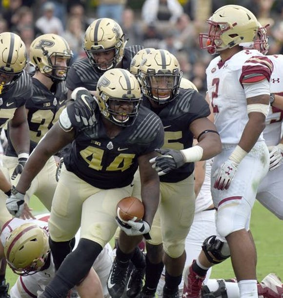 Purdue defensive tackle Anthony Watts celebrates an interception against Boston College