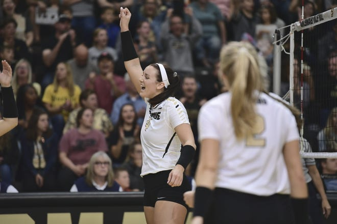 Caitlyn Newton celebrates after one of her career-high 16 kills Saturday against Northwestern.