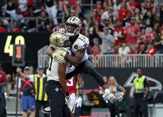 New Orleans Saints wide receiver Cameron Meredith (81) celebrates his touchdown reception with wide receiver Michael Thomas (13) in the third quarter Sunday against the Atlanta Falcons at the Mercedes-Benz Stadium in Atlanta.