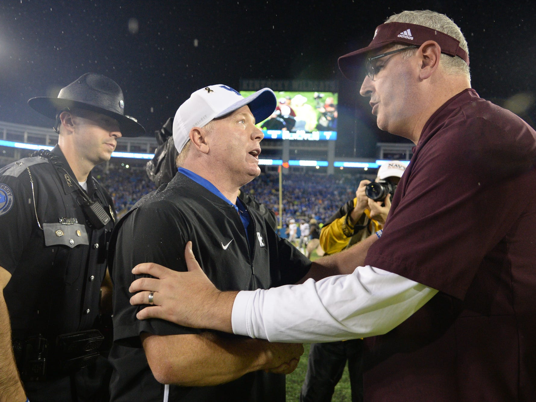 UK head coach Mark Stoops shakes hands with Mississippi State head coach Joe Moorhead after the University of Kentucky football game against Mississippi State at Kroger Field in Lexington, Kentucky on Saturday, September 22, 2018.