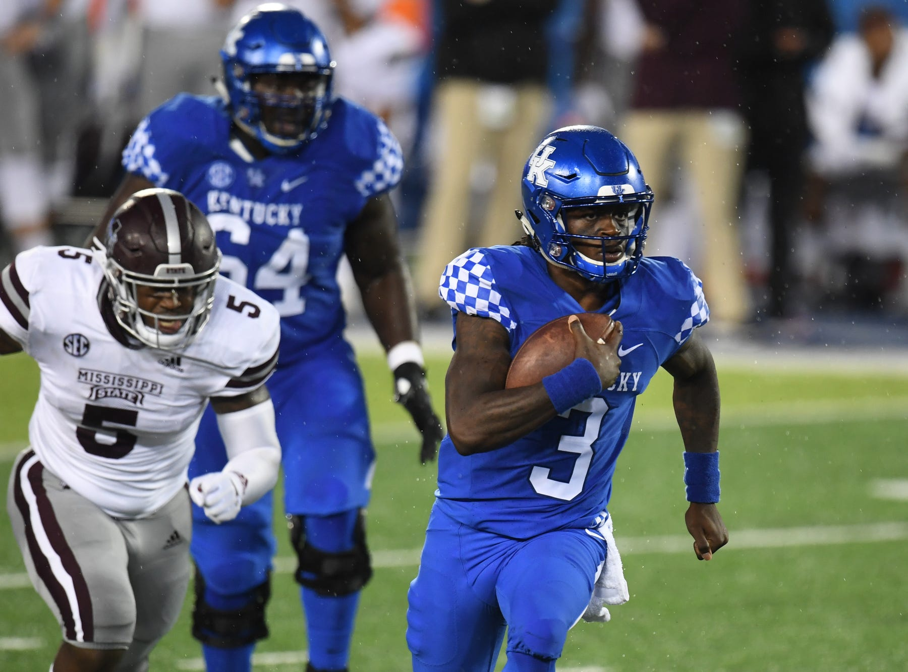 UK QB Terry Wilson keeps the ball during the University of Kentucky football game against Mississippi State at Kroger Field in Lexington, Kentucky on Saturday, September 22, 2018.