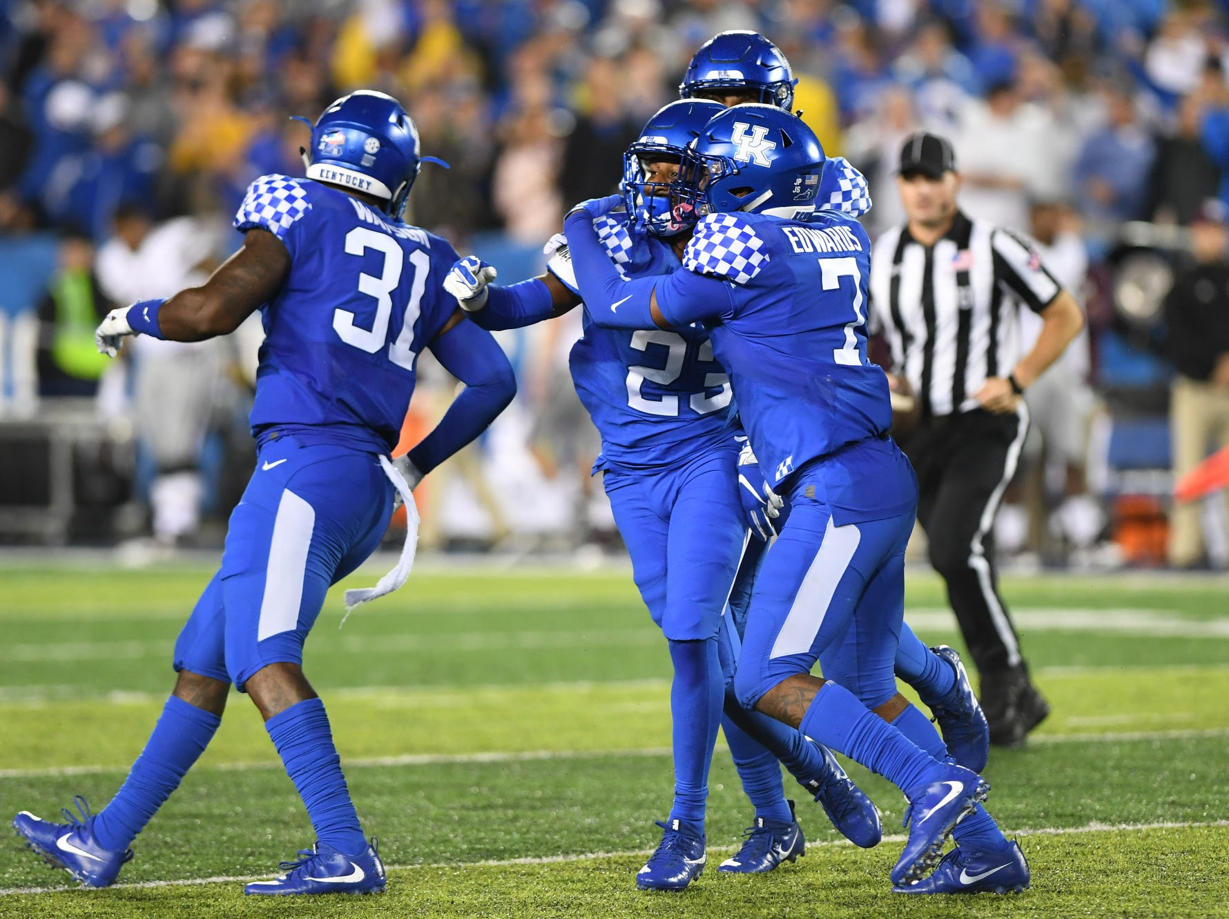 UK SS Tyrell Ajian is congratulated by teammates after intercepting the ball against Mississippi State at Kroger Field in Lexington, Kentucky on Saturday, September 22, 2018.