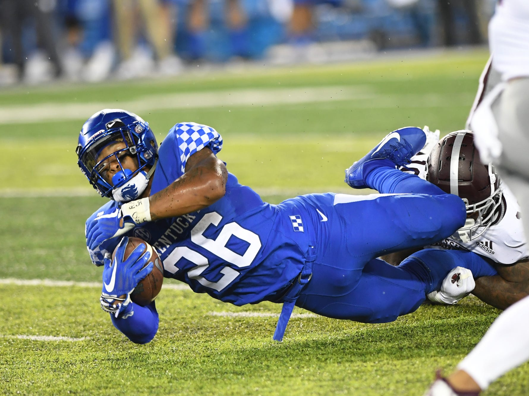 UK RB Benny Snell, Jr. dives forward with the ball during the University of Kentucky football game against Mississippi State at Kroger Field in Lexington, Kentucky on Saturday, September 22, 2018.