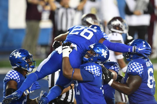 UK RB Benny Snell, Jr. is hoisted up by teammates after scoring a touchdown during the University of Kentucky football game against Mississippi State at Kroger Field in Lexington, Kentucky on Saturday, September 22, 2018.