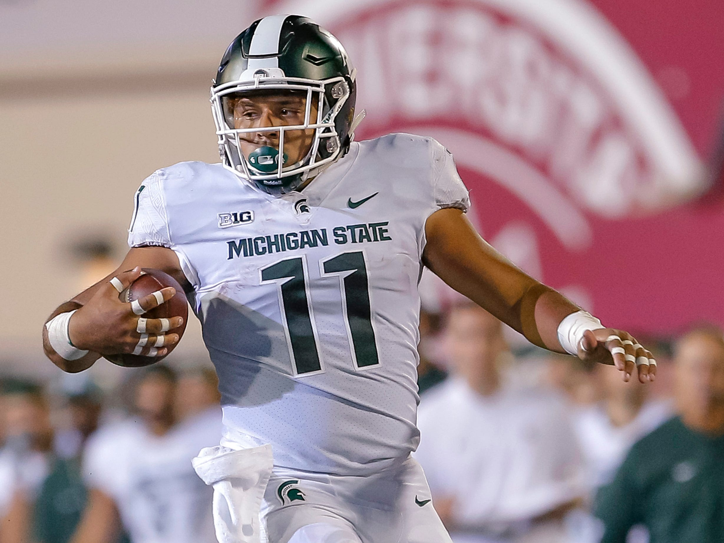 Connor Heyward #11 of the Michigan State Spartans pulls up while rushing during the game against the Indiana Hoosiers at Memorial Stadium on September 22, 2018 in Bloomington, Indiana.