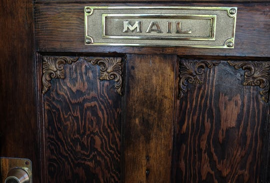 An old fashioned mail slot graces the door of Scoops Ice Cream in Old Town Saturday, Sept. 22, 2018.