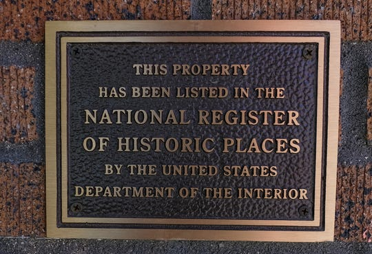 A plaque shows the property that houses Scoops Ice Cream in Old Town is a registered national historic site. Saturday, Sept. 22, 2018.