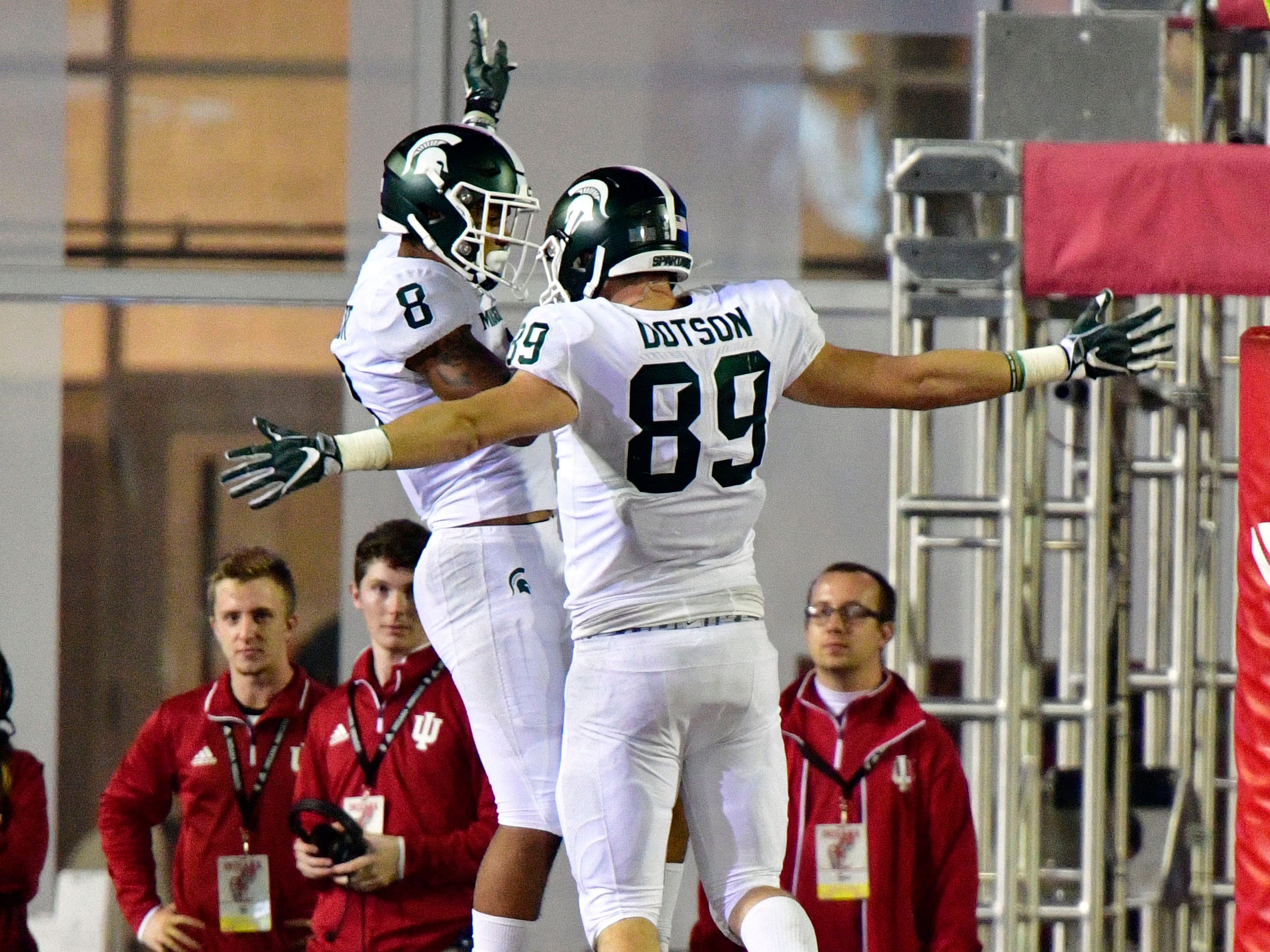 Michigan State Spartans wide receiver Jalen Nailor (8) celebrates running a ball the length of the field for a touchdown with tight end Matt Dotson (89) during the second half at Memorial Stadium. The Michigan State Spartans defeated the Indiana Hoosiers 35 to 21.
