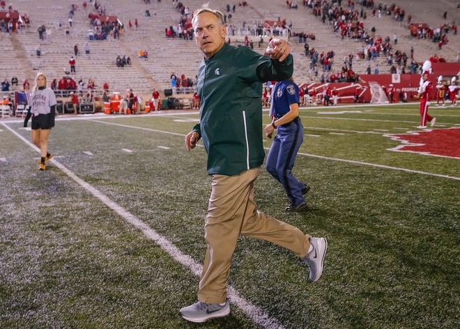 Head coach Mark Dantonio of the Michigan State Spartans runs off the field and acknowledges fans following the win over the Indiana Hoosiers at Memorial Stadium on September 22, 2018 in Bloomington, Indiana.