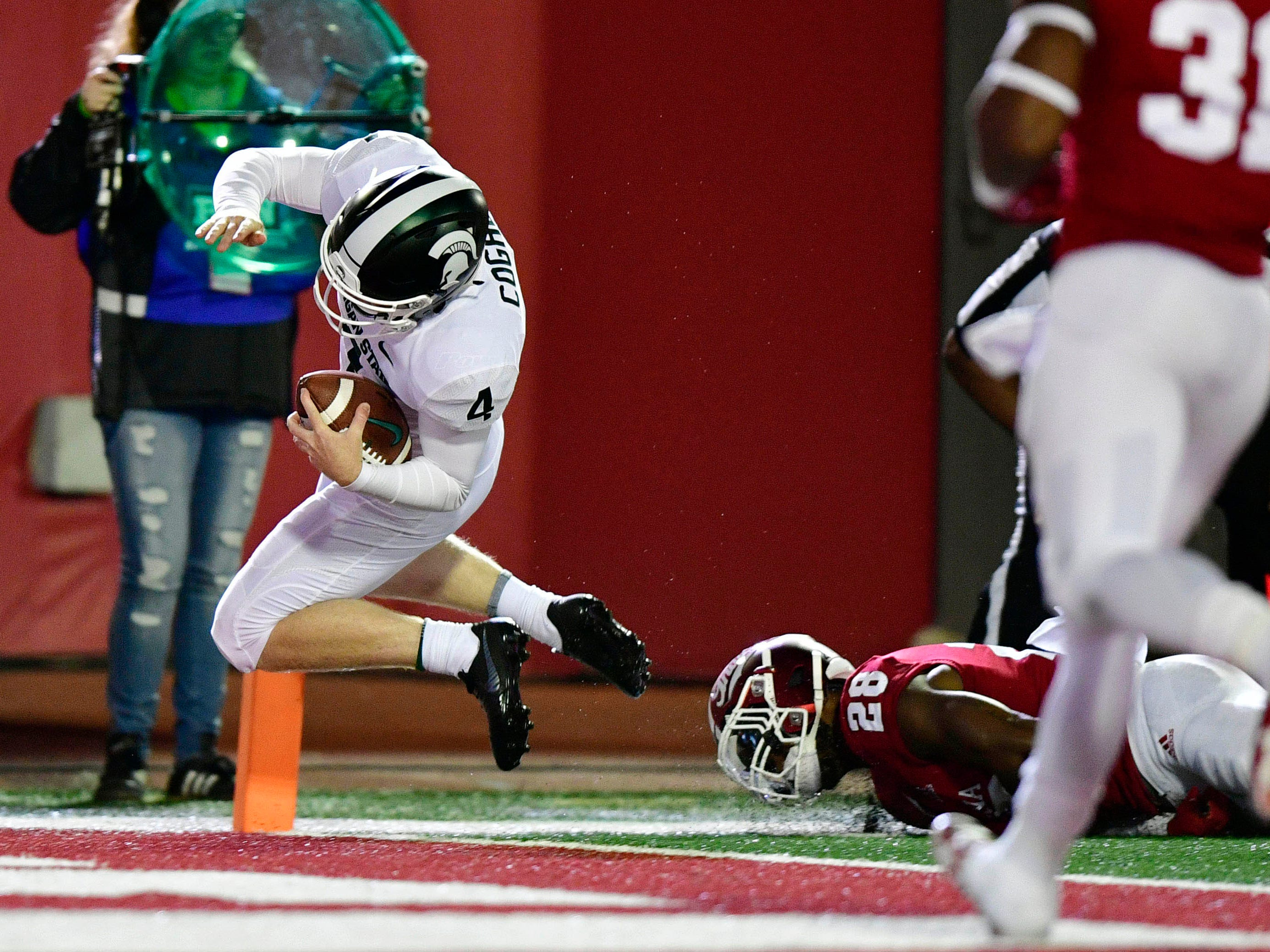 Michigan State Spartans wide receiver C.J. Hayes (4) jumps into the end zone to score a touchdown during the second half of the game against Indiana at Memorial Stadium. The Michigan State Spartans defeated the Indiana Hoosiers 35 to 21.