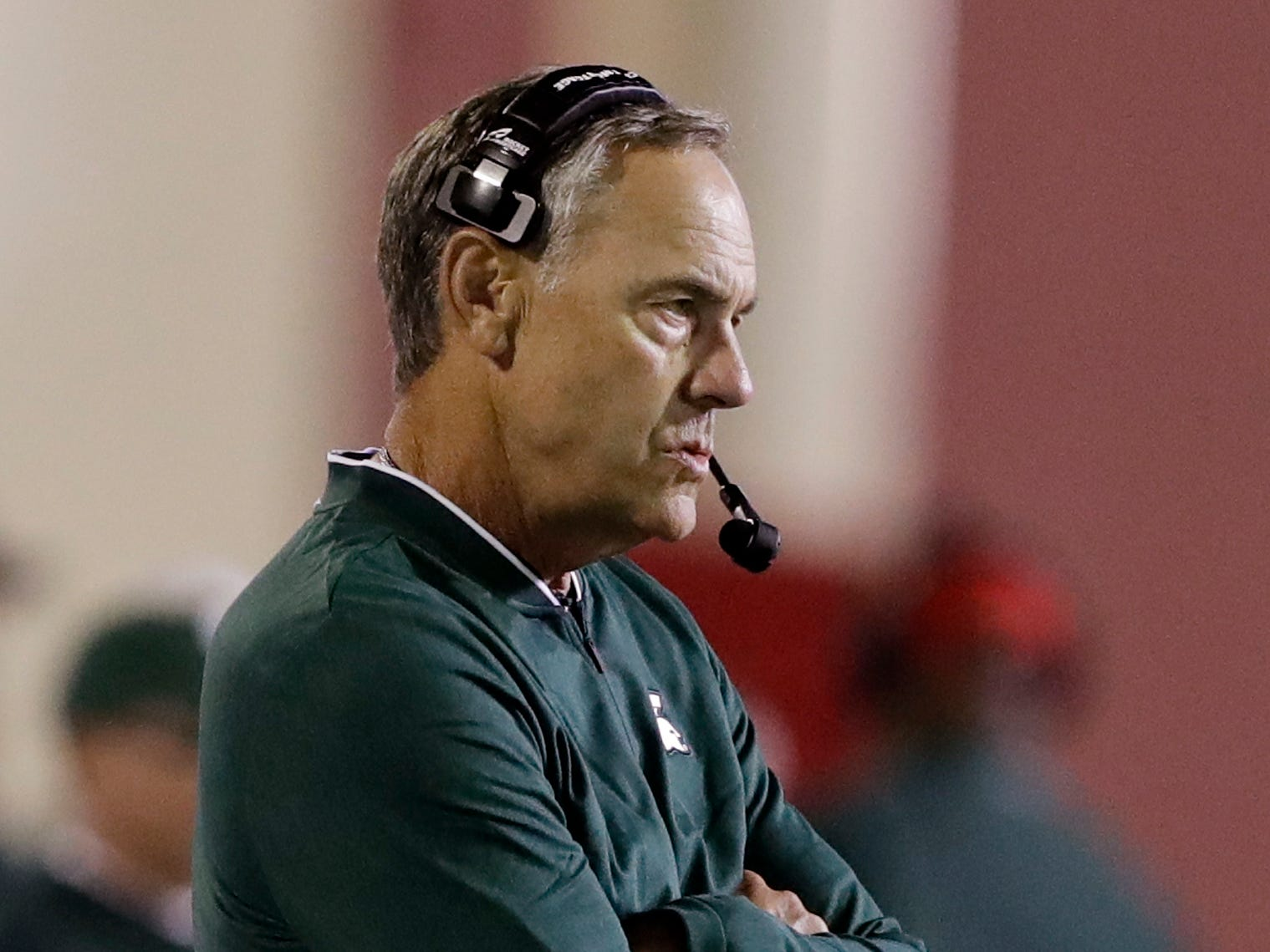 Michigan State head coach Mark Dantonio watches during the first half of an NCAA college football game against Indiana, Saturday, Sept. 22, 2018, in Bloomington, Ind.